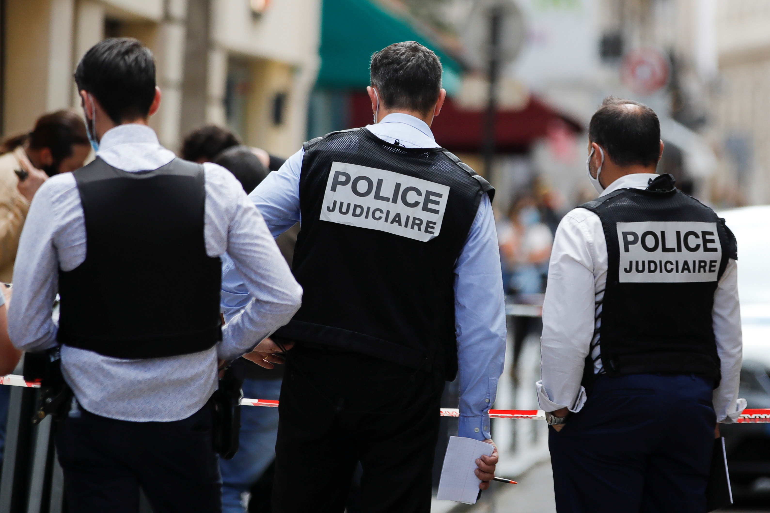 Police investigators stand next to Dinh Van jewelry store after a robbery in central Paris, France July 30, 2021. REUTERS/Sarah Meyssonnier