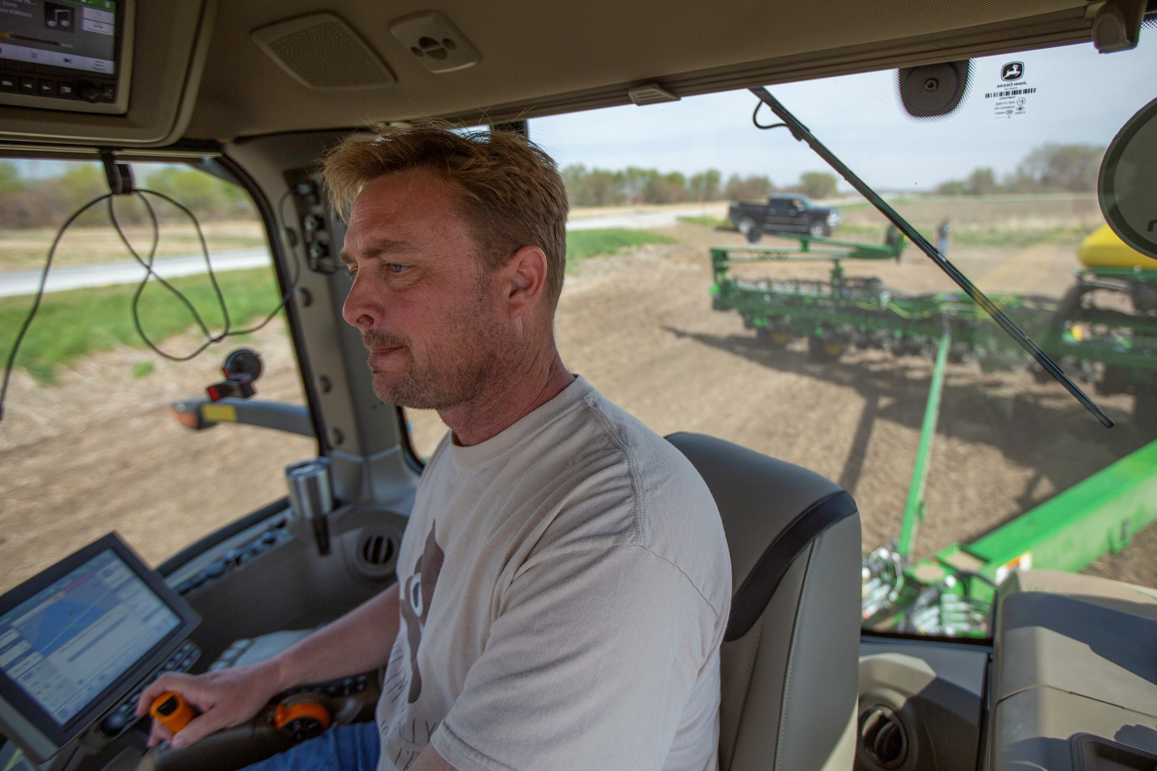 Chris Hays drives a new tractor and planter during spring planting at their farm in Malvern, Iowa, U.S., April 27, 2021. REUTERS/Rachel Mummey