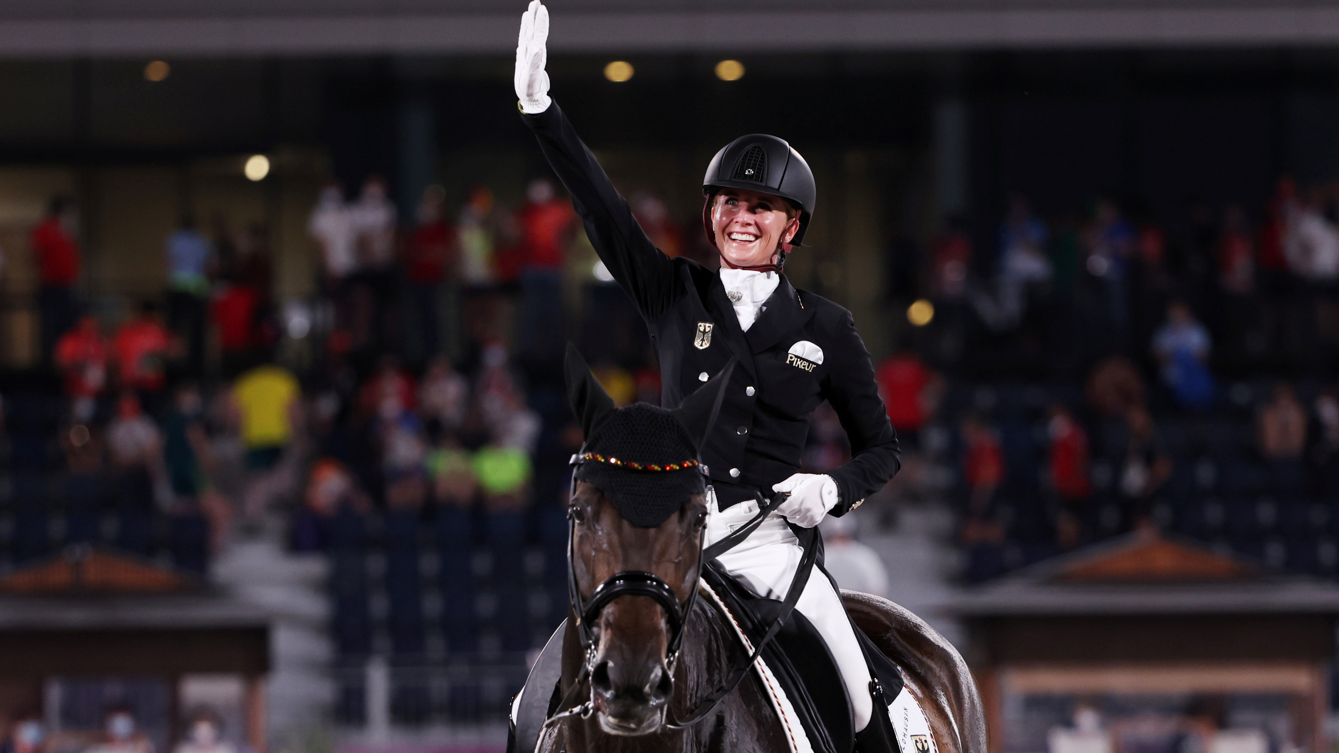 Tokyo 2020 Olympics - Equestrian - Dressage - Grand Prix Special - Team - Equestrian Park - Tokyo, Japan - July 27, 2021. Jessica von Bredow-Werndl of Germany on her horse TSF Dalera reacts. REUTERS/Alkis Konstantinidis