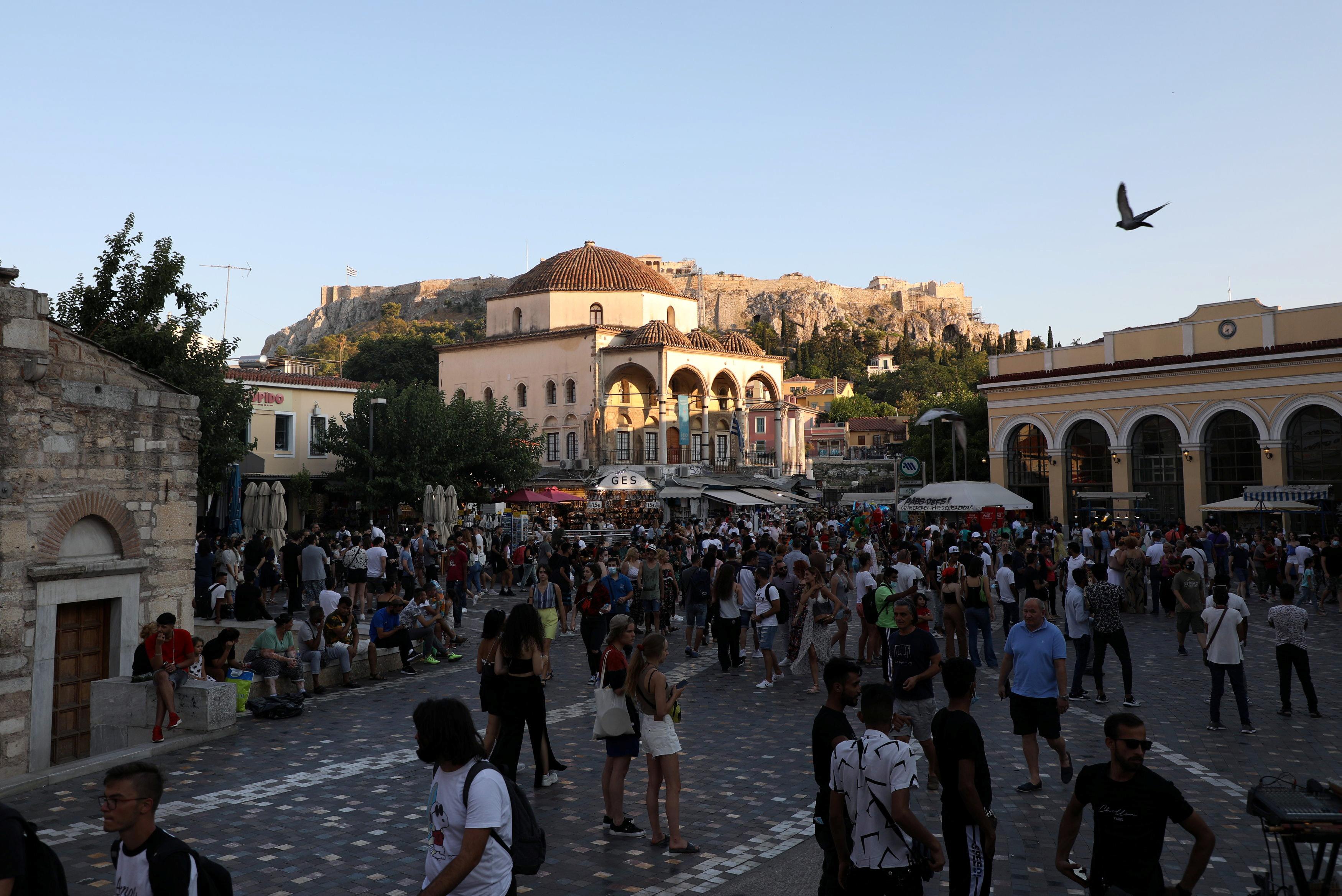 People visit Monastiraki square in Athens, Greece, July 25, 2021. Picture taken July 25, 2021. REUTERS/Louiza Vradi