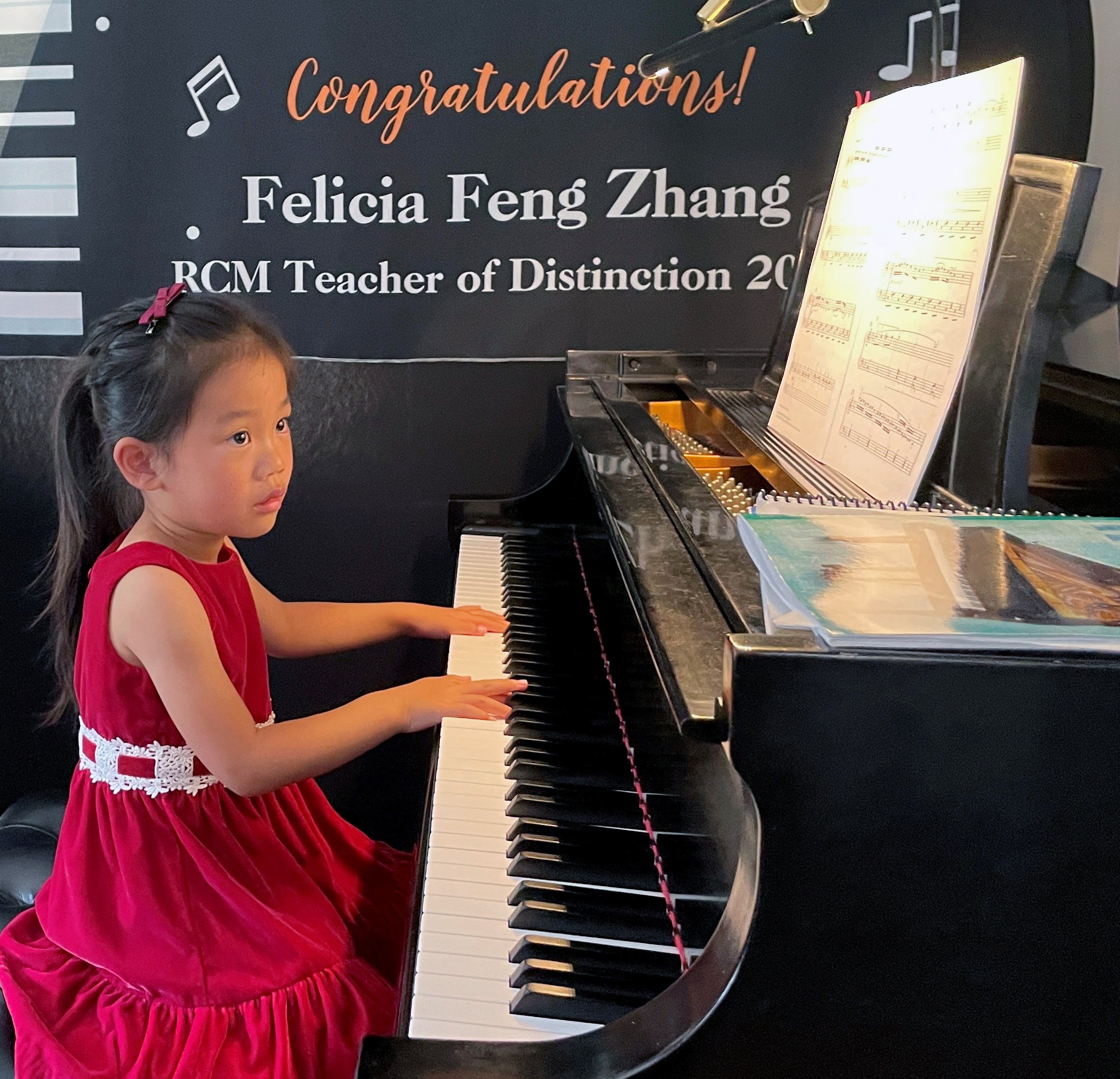 Brigitte Xie, 4, plays piano at piano teacher Felicia Feng Zhang's home in Greenwich, Connecticut, U.S. July 31, 2021. REUTERS/Roselle Chen