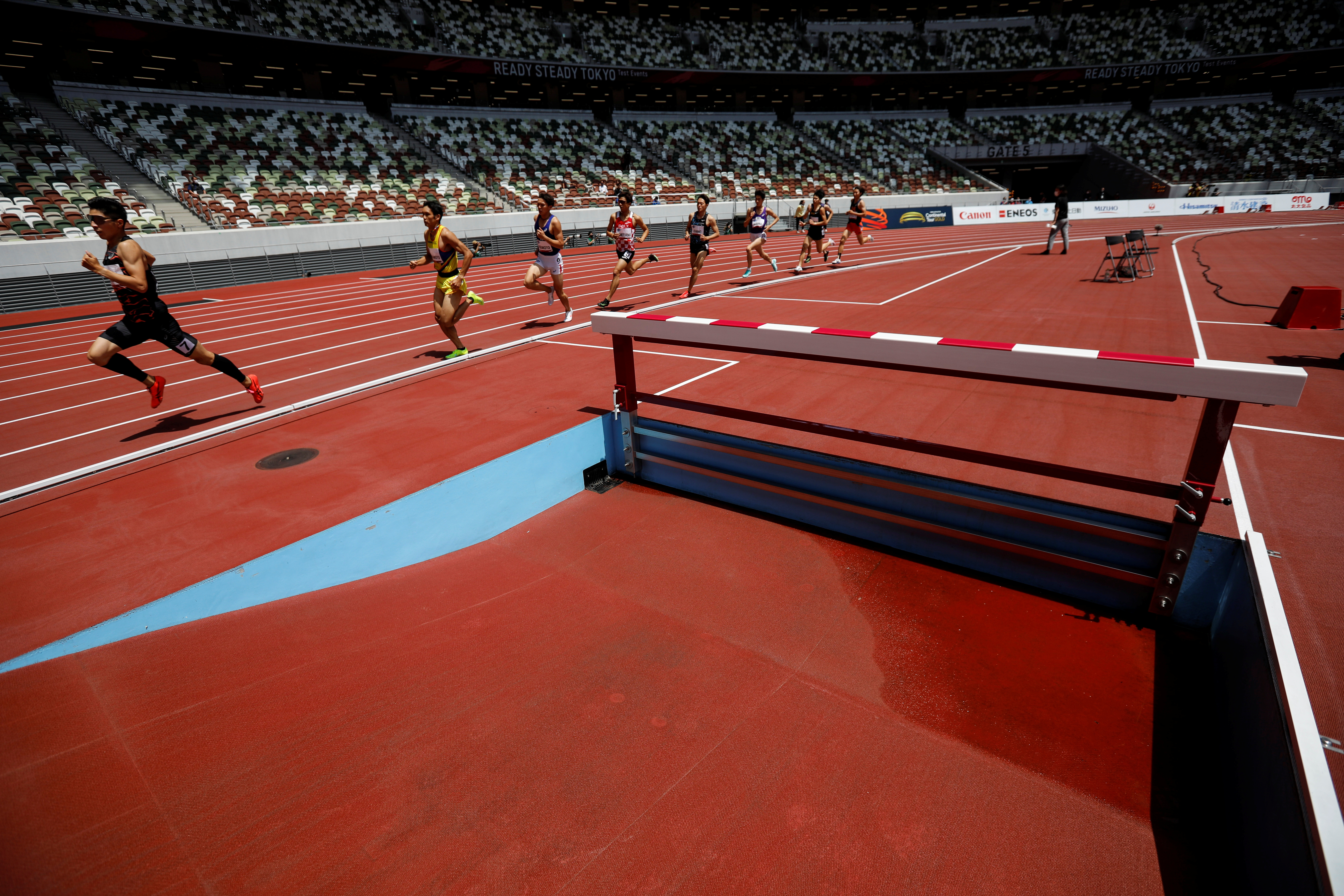 Olympics - Tokyo 2020 Olympic Games Test Event - Athletics - Olympic Stadium, Tokyo, Japan - May 9, 2021.   Japan's Daichi Setoguchi (7) runs ahead of others during the men's 800m final at the morning session of the Athletics test event. REUTERS/Issei Kato