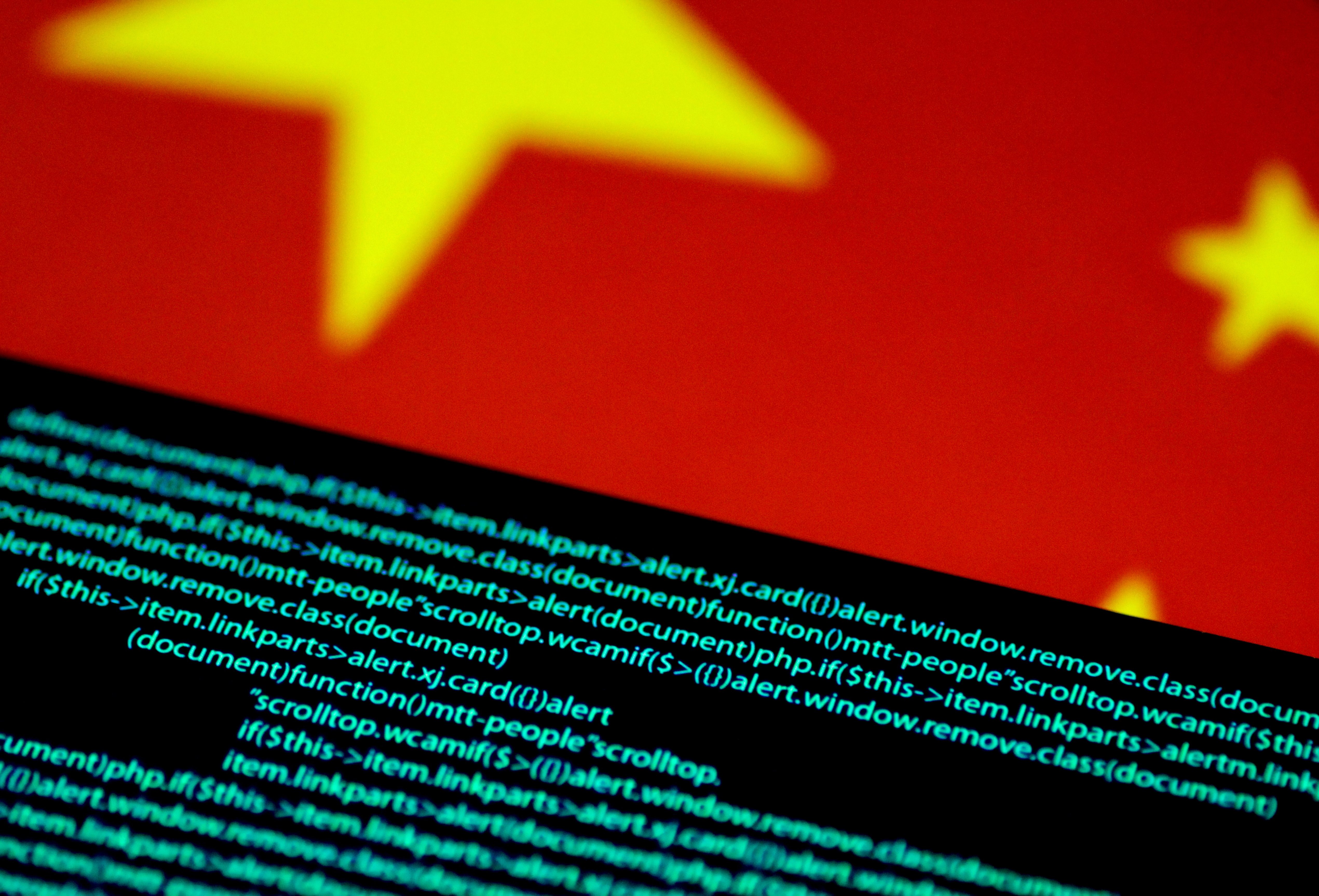 Computer code is seen on a screen above a Chinese flag in this July 12, 2017 illustration photo.   REUTERS/Thomas White/Illustration/File Photo/File Photo