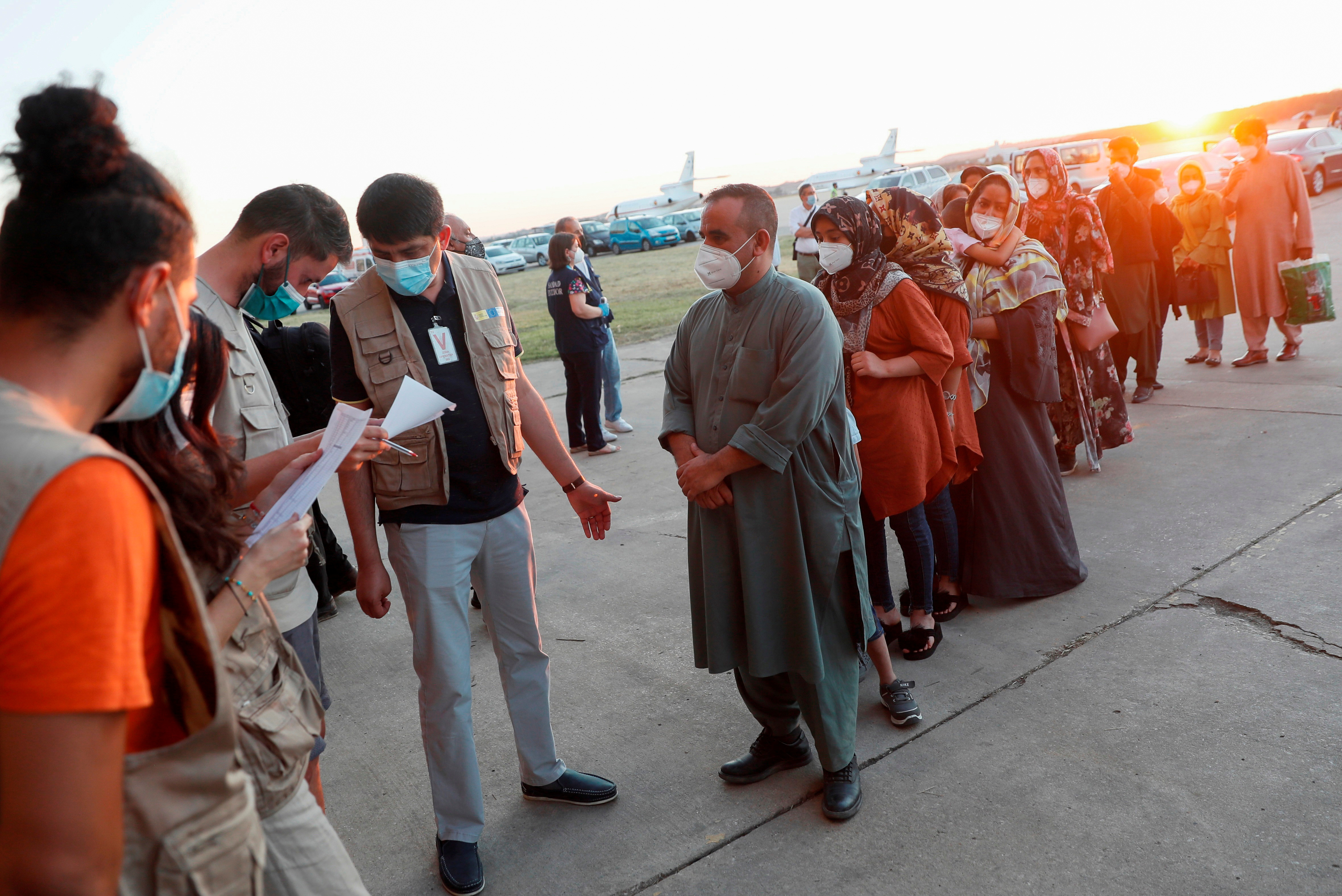 Afghan citizens who were evacuated from Kabul arrive at Torrejon Air Base in Torrejon de Ardoz, outside Madrid, Spain, August 20, 2021. Picture taken August 20, 2021. Mariscal/Pool via REUTERS