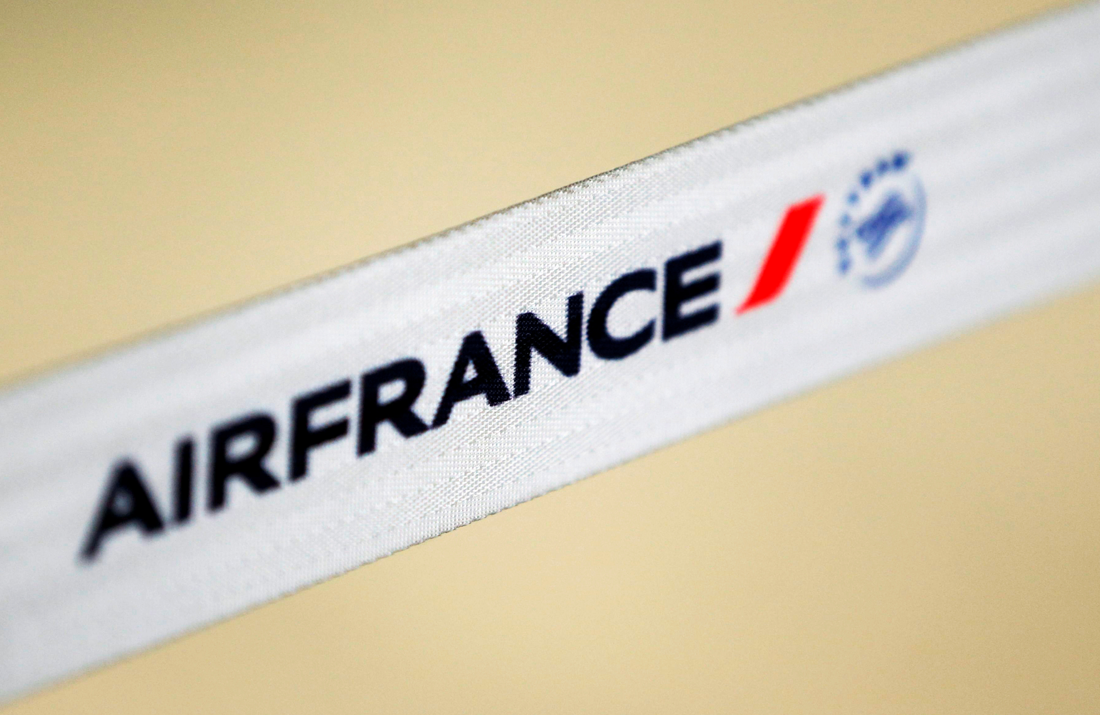 Air France logo is pictured at the Air France check-in at Bordeaux-Merignac airport, as Air France pilots, cabin and ground crews unions call for a strike over salaries in Merignac near Bordeaux, France April 7, 2018. REUTERS/Regis Duvignau