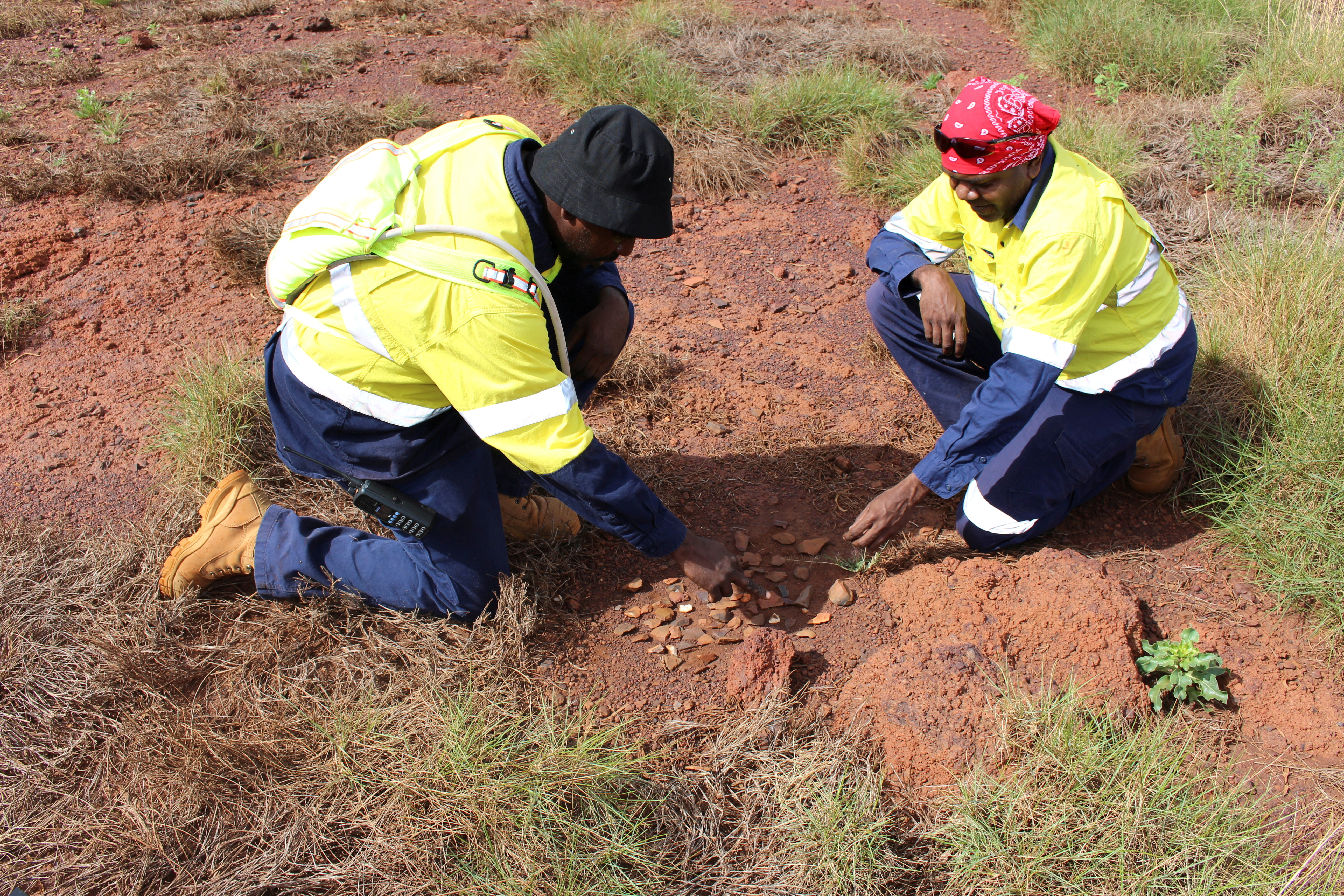 Puutu Kunti Kurrama and Pinikura (PKKP) Project Advisor John Ashburton (R) works on the collection of scatterings in the Pilbara region of Western Australia, May 10, 2021.  Puutu Kunti Kurrama and Pinikura (PKKP)/Handout via REUTERS