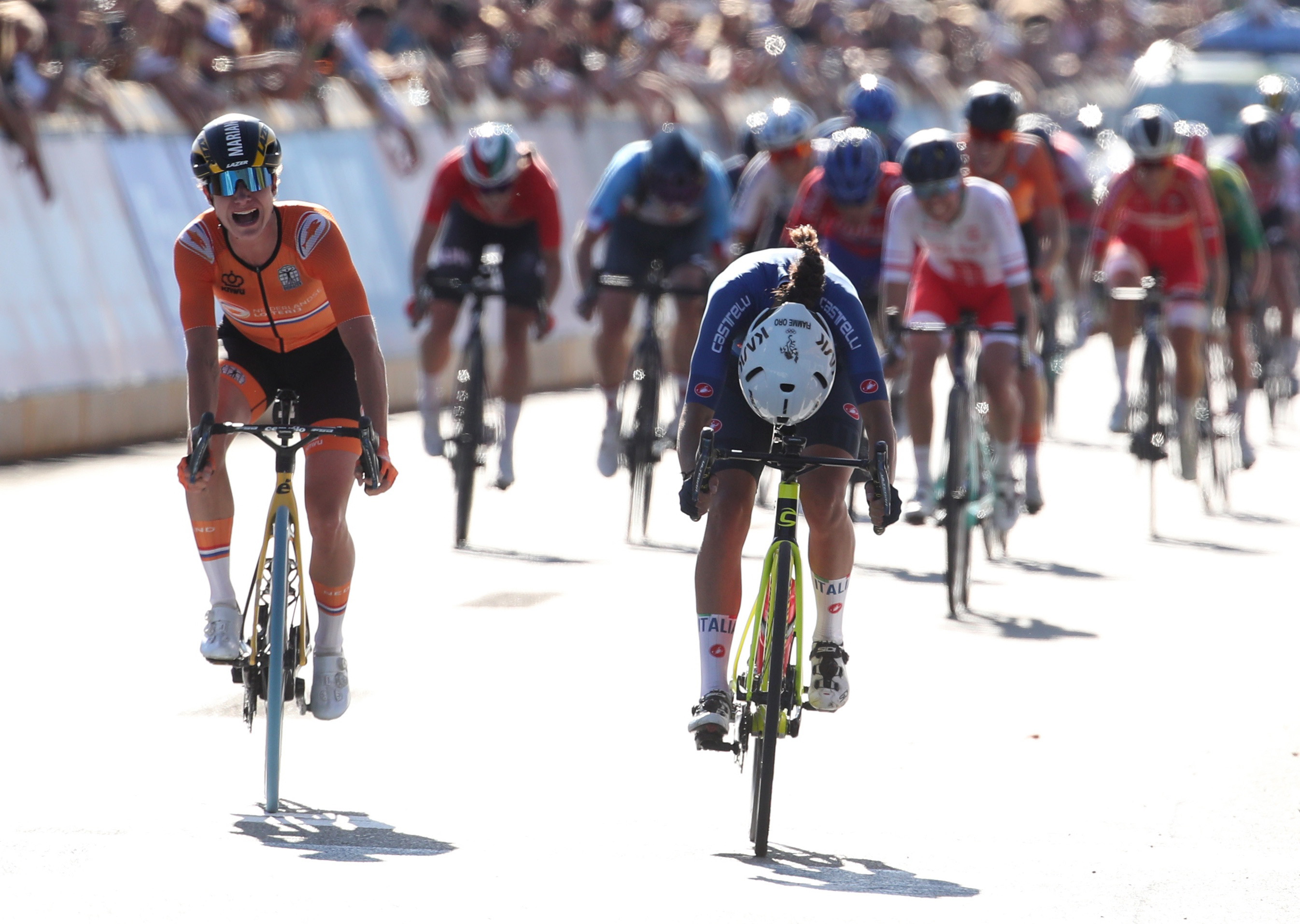 Cycling - UCI Road World Championships -  Leuven, Belgium - September 25, 2021 Italy's Elisa Balsamo crosses the finish line to win the race REUTERS/Yves Herman