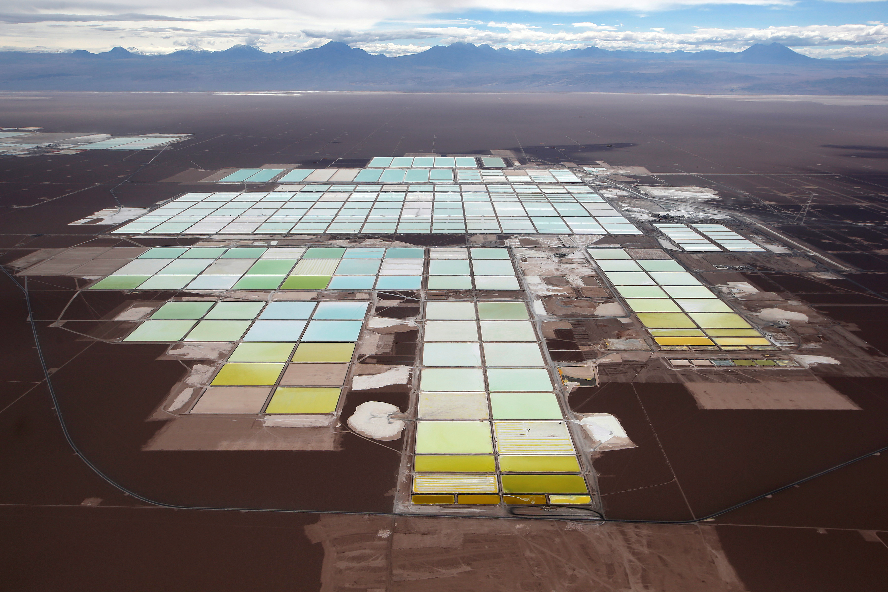 An aerial view shows the brine pools and processing areas of the Soquimich (SQM) lithium mine on the Atacama salt flat, the world's second largest salt flat and the largest lithium deposit currently in production, with over a quarter of the world's known reserves, in the Atacama desert of northern Chile, January 10, 2013.  REUTERS/Ivan Alvarado