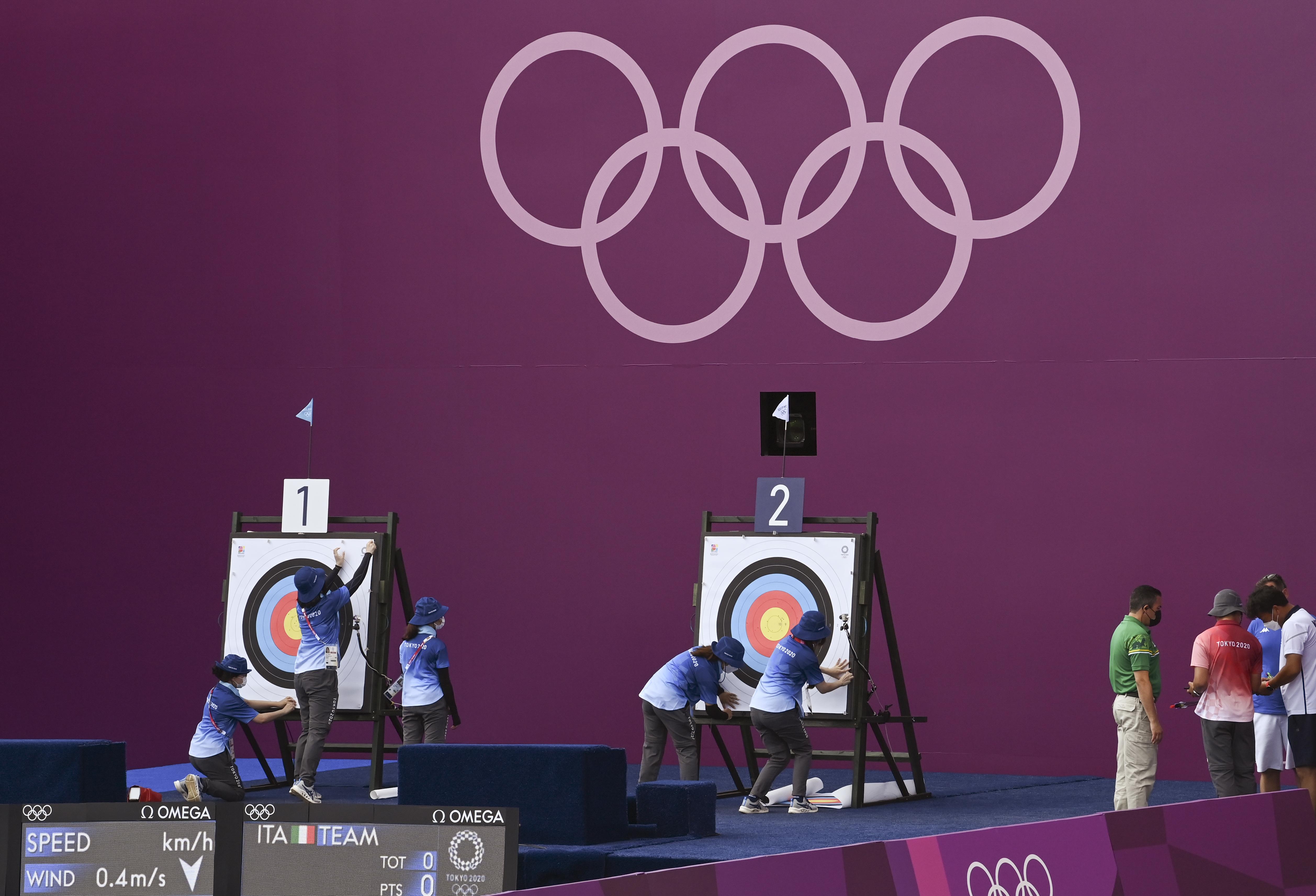 Tokyo 2020 Olympics - Archery - Women's Team - Quarterfinals - Yumenoshima Archery Field, Tokyo, Japan - July 25, 2021. Volunteers prepare targets REUTERS/Clodagh Kilcoyne