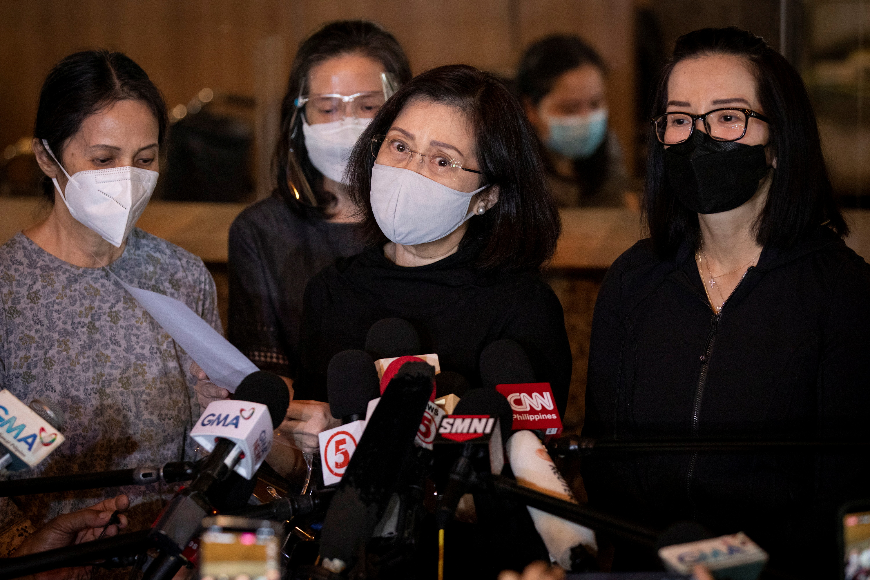 Sisters of former Philippine President Benigno Aquino speak to the media after the passing of their 61-year-old brother, at The Heritage Memorial Park in Taguig City, Philippines, June 24, 2021. REUTERS/Eloisa Lopez