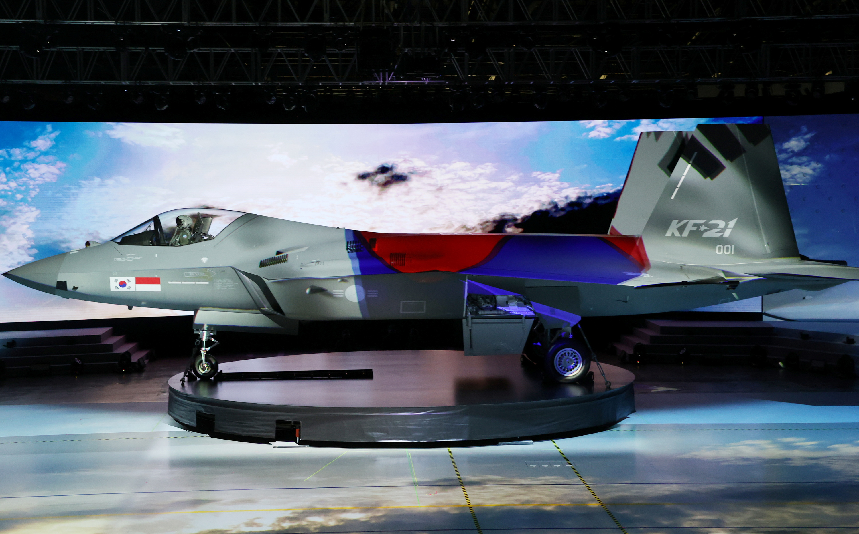 The country's first homegrown fighter jet called KF-21 is unveiled during its rollout ceremony in Sacheon, South Korea, April 9, 2021.   Yonhap via REUTERS