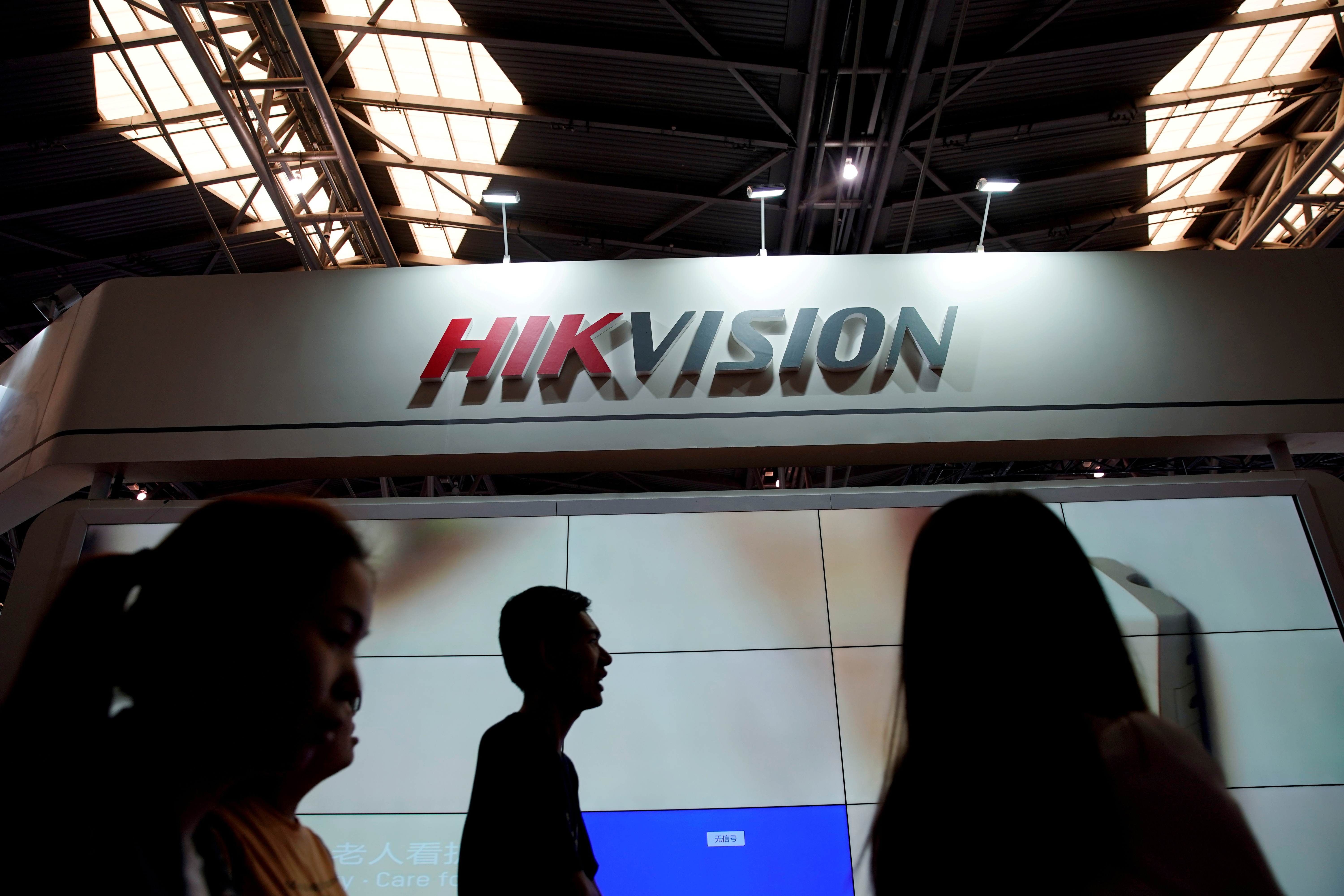 People visit a HIKVision booth at the security exhibition in Shanghai, China May 24, 2019. REUTERS/Aly Song