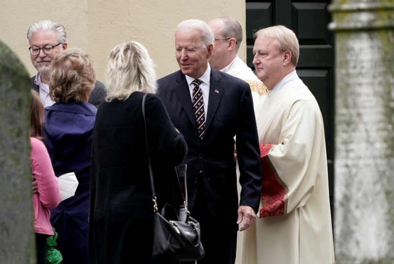 U.S. President Joe Biden speaks with people outside St. Joseph on the Brandywine Catholic Church, in Wilmington, Delaware, U.S. May 30, 2021. REUTERS/Ken Cedeno/File Photo