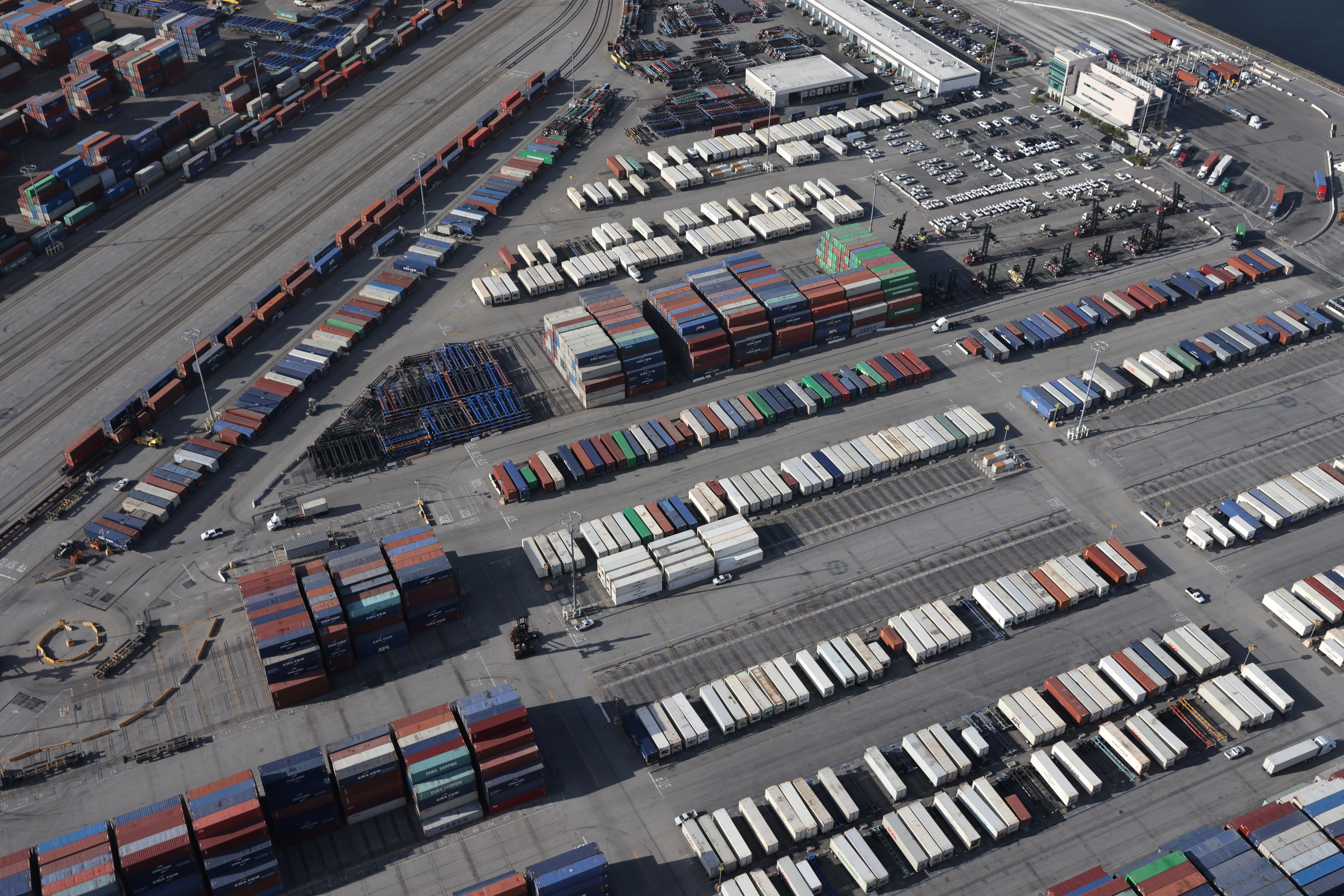 Shipping containers sit on the dock at a container terminal at the Port of Long Beach-Port of Los Angeles complex, amid the coronavirus disease (COVID-19) pandemic, in Los Angeles, California, U.S., April 7, 2021. REUTERS/Lucy Nicholson