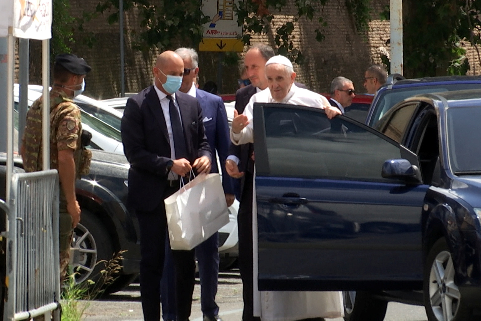 Pope Francis leaves the car to greet policemen before entering the Vatican after being discharged from Gemelli hospital in this screengrab taken from a video in Rome, Italy, July 14, 2021. Cristiano Corvino/REUTERS TV via REUTERS