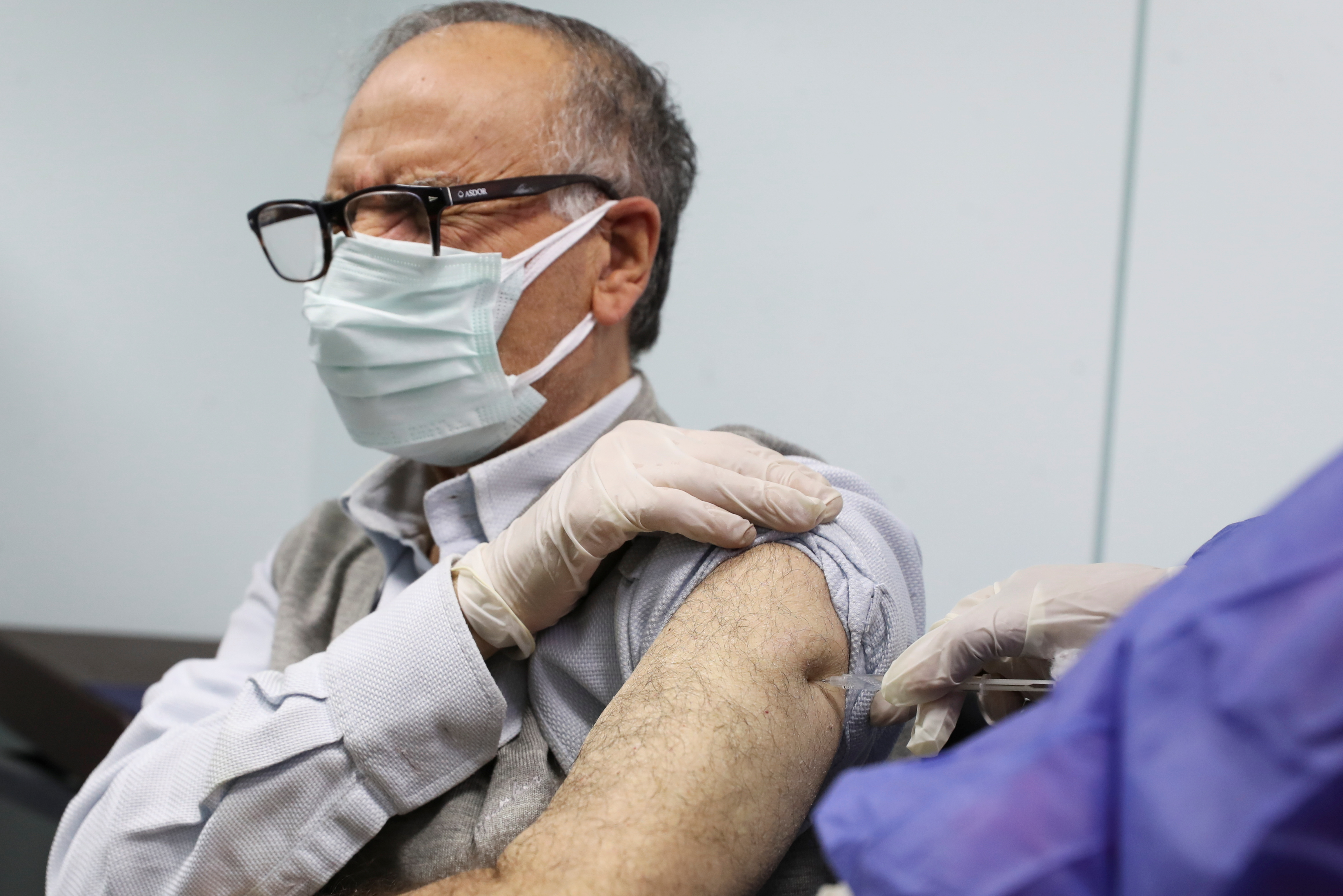 A man receives a dose of the AstraZeneca vaccine against the coronavirus disease (COVID-19) in Cairo, Egypt March 4, 2021. REUTERS/Mohamed Abd El Ghany