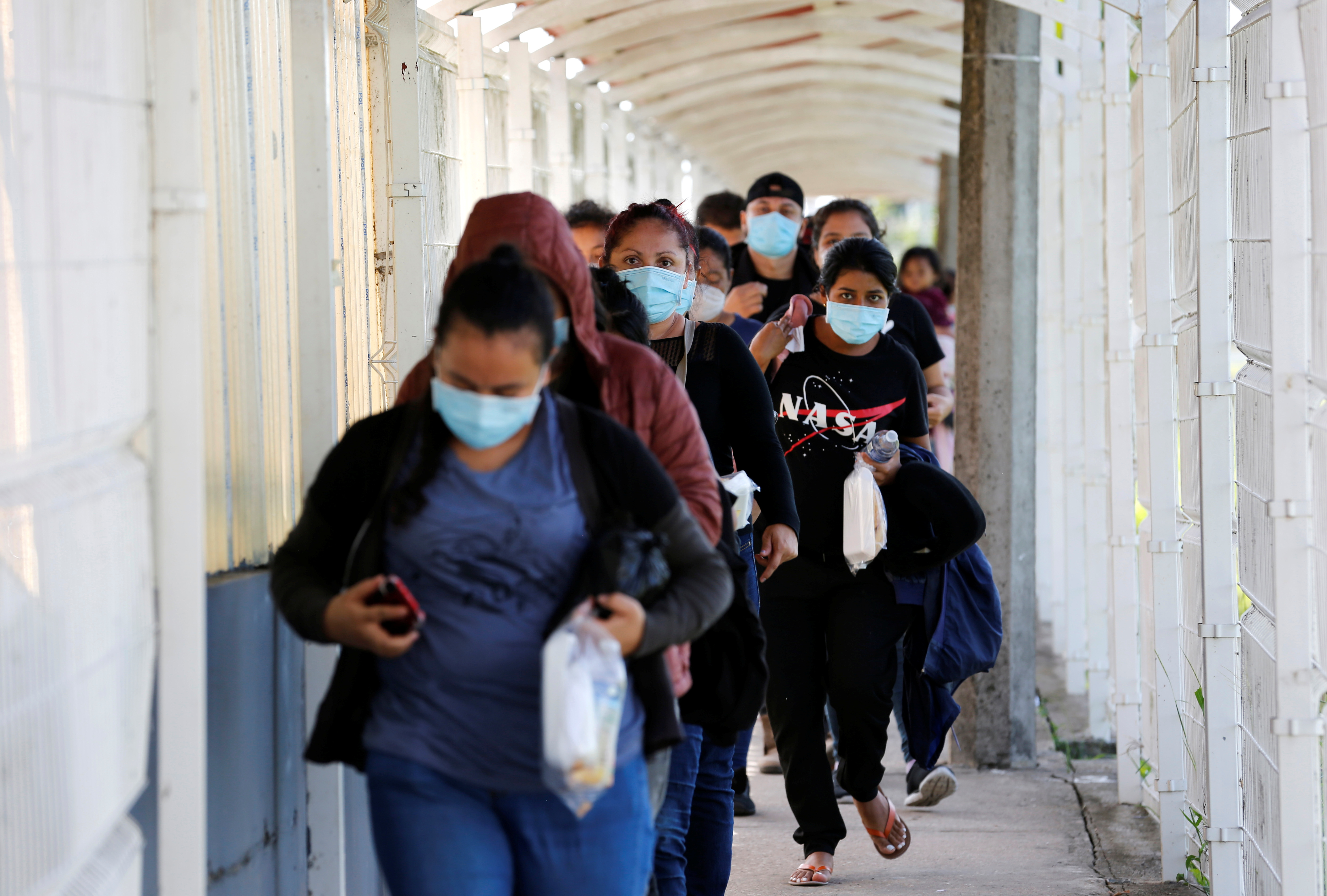 Central American migrants cross the border between Mexico and Guatemala, after being expelled by U.S. and Mexican officials, in El Ceibo, Guatemala August 15, 2021. Picture taken August 15, 2021. REUTERS/Luis Echeverria