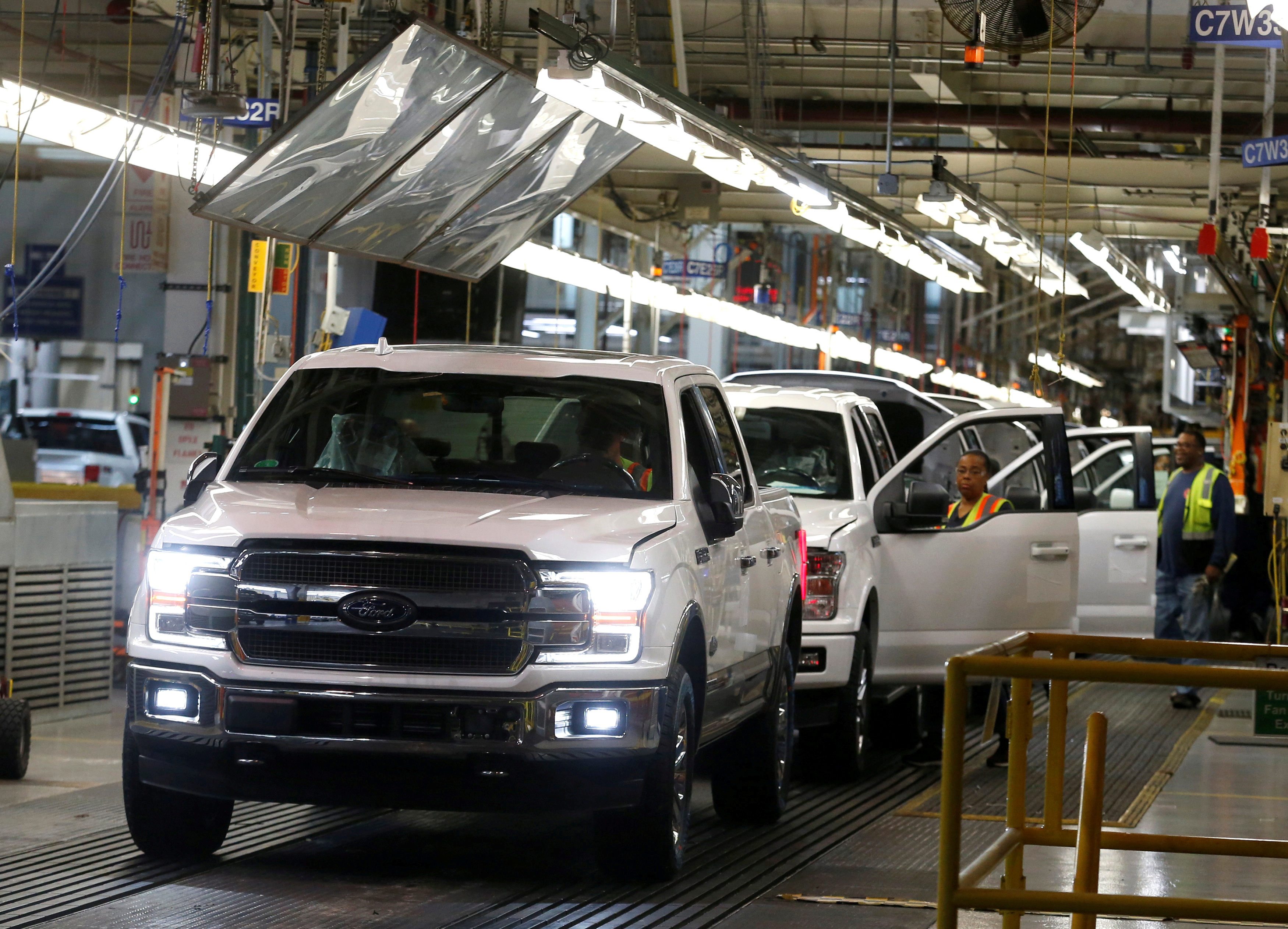 Newly assembled Ford F150 pick-up trucks are driven off the assembly line during the 100-year celebration of the Ford River Rouge Complex in Dearborn, Michigan U.S. September 27, 2018.  REUTERS/Rebecca Cook/File Photo