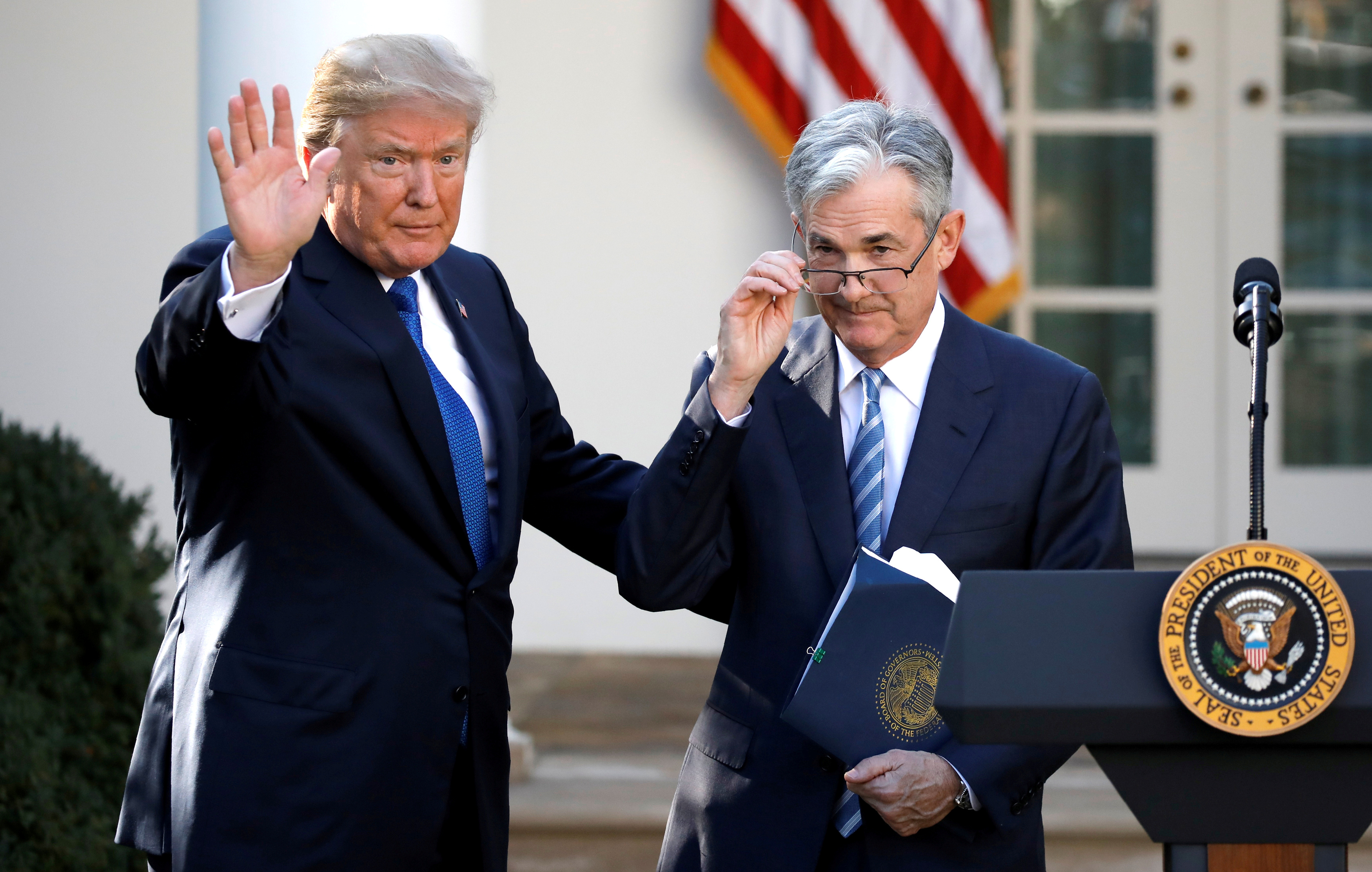 U.S. President Donald Trump gestures with Jerome Powell, his nominee to become chairman of the U.S. Federal Reserve at the White House in Washington, U.S., November 2, 2017. REUTERS/Carlos Barria/File Photo
