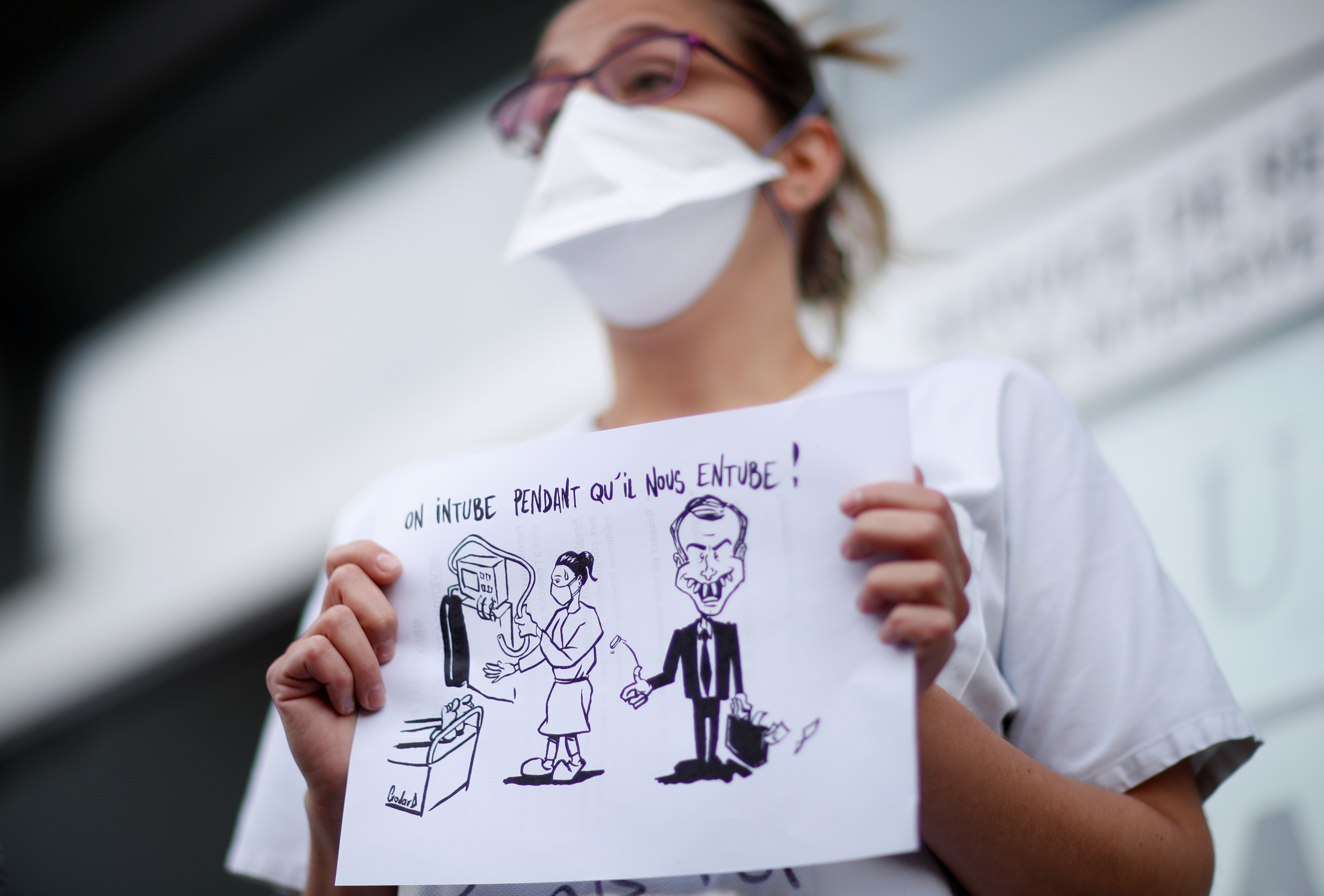 A nurse of the Intensive Care Unit (ICU) on strike attends a demonstration in front of the Robert Ballanger hospital in Aulnay-sous-Bois near Paris during a national strike to demand better recognition of their work and salary increases amid the coronavirus disease (COVID-19) outbreak in France, May 11, 2021.REUTERS/Gonzalo Fuentes