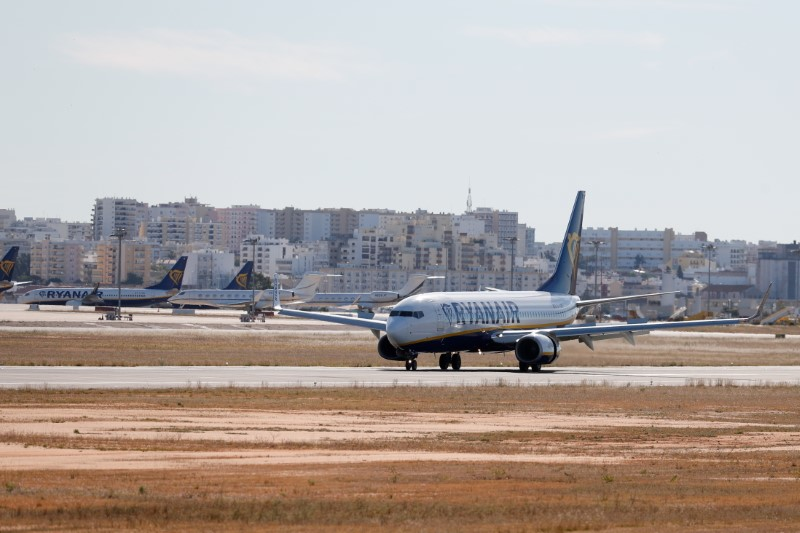 A Ryanair flight from Manchester arrives at Faro Airport on the first day that Britons are allowed to enter Portugal without needing to quarantine, as coronavirus disease (COVID-19) restrictions continue to ease, in Faro, Portugal, May 17, 2021. REUTERS/Pedro Nunes/File Photo