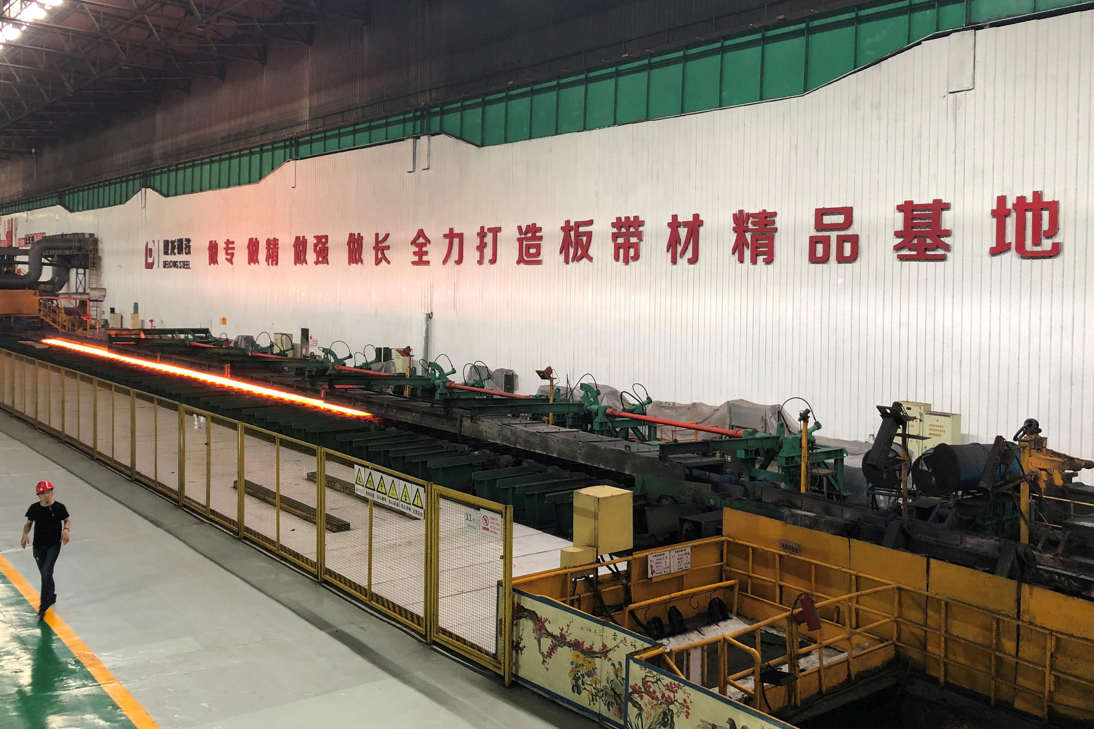 A man walks inside a steel plant of Delong Steel in Xingtai, Hebei province, China June 20, 2019. Picture taken June 20, 2019.  REUTERS/Muyu Xu/File Photo