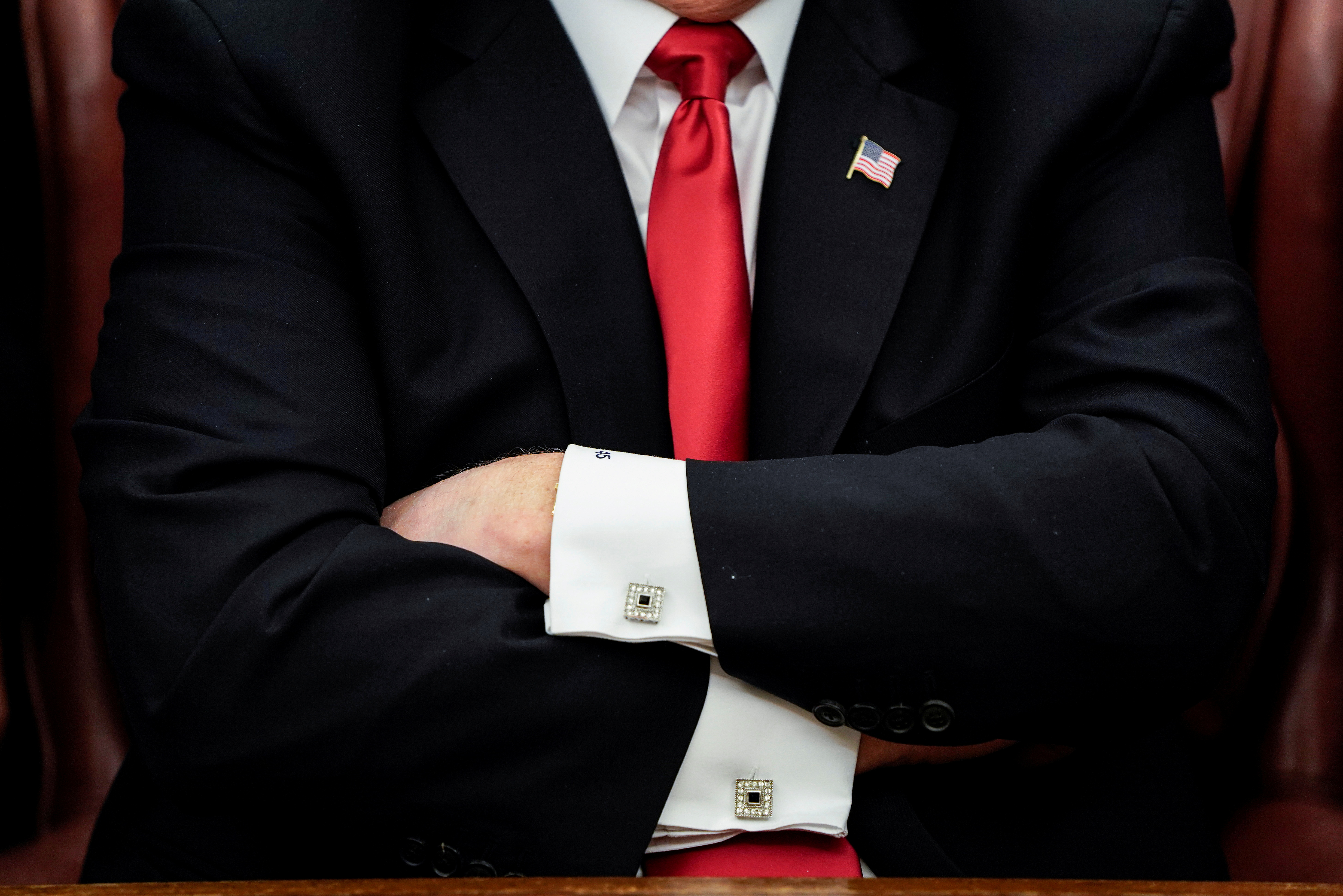 U.S. President Donald Trump crosses his arms during a signing ceremony at the White House in Washington, U.S., December 21, 2018.      REUTERS/Joshua Roberts/File Photo