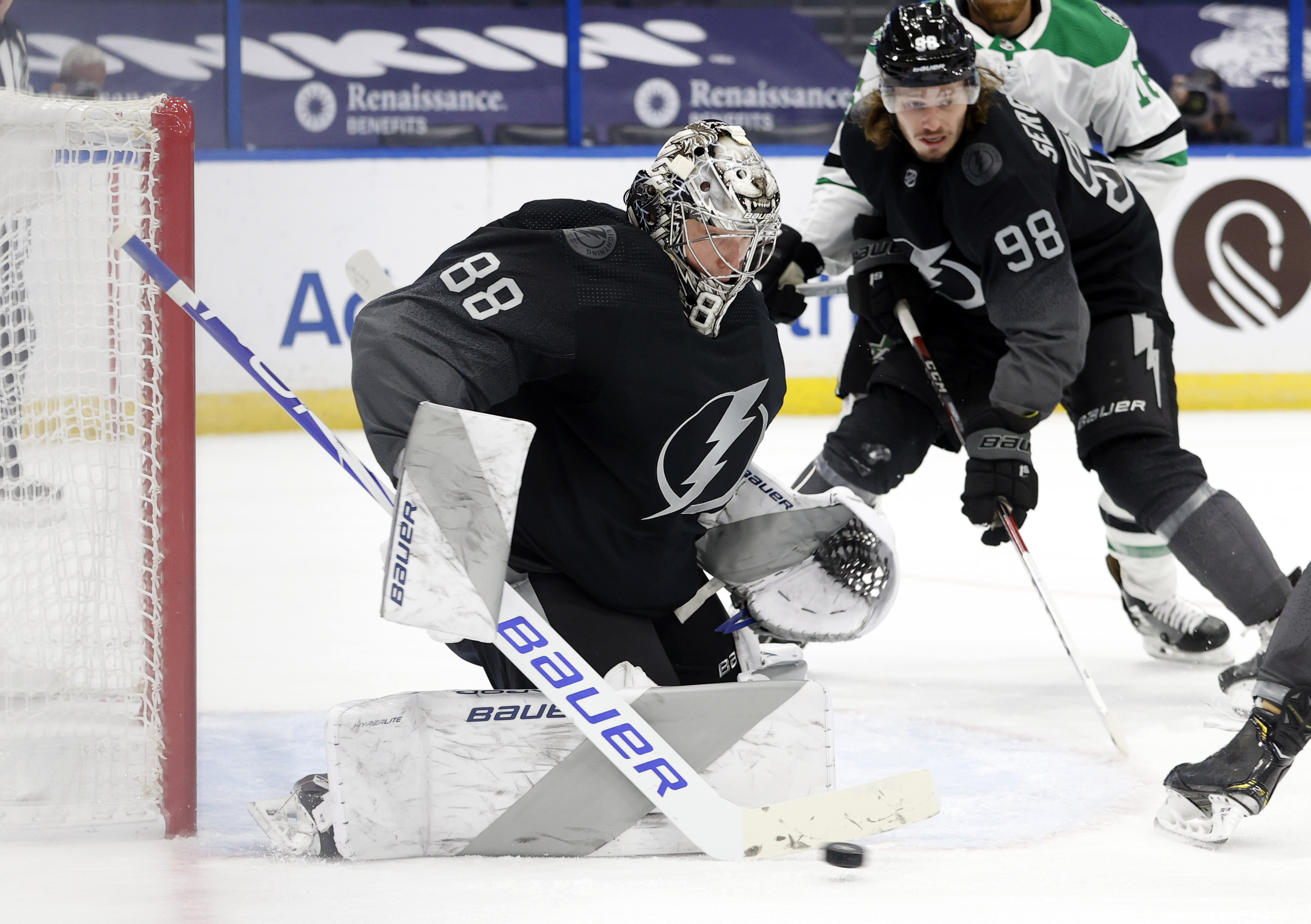 Feb 27, 2021; Tampa, Florida, USA; Tampa Bay Lightning goaltender Andrei Vasilevskiy (88) makes a save against the Dallas Stars during the second period at Amalie Arena. Mandatory Credit: Kim Klement-USA TODAY Sports
