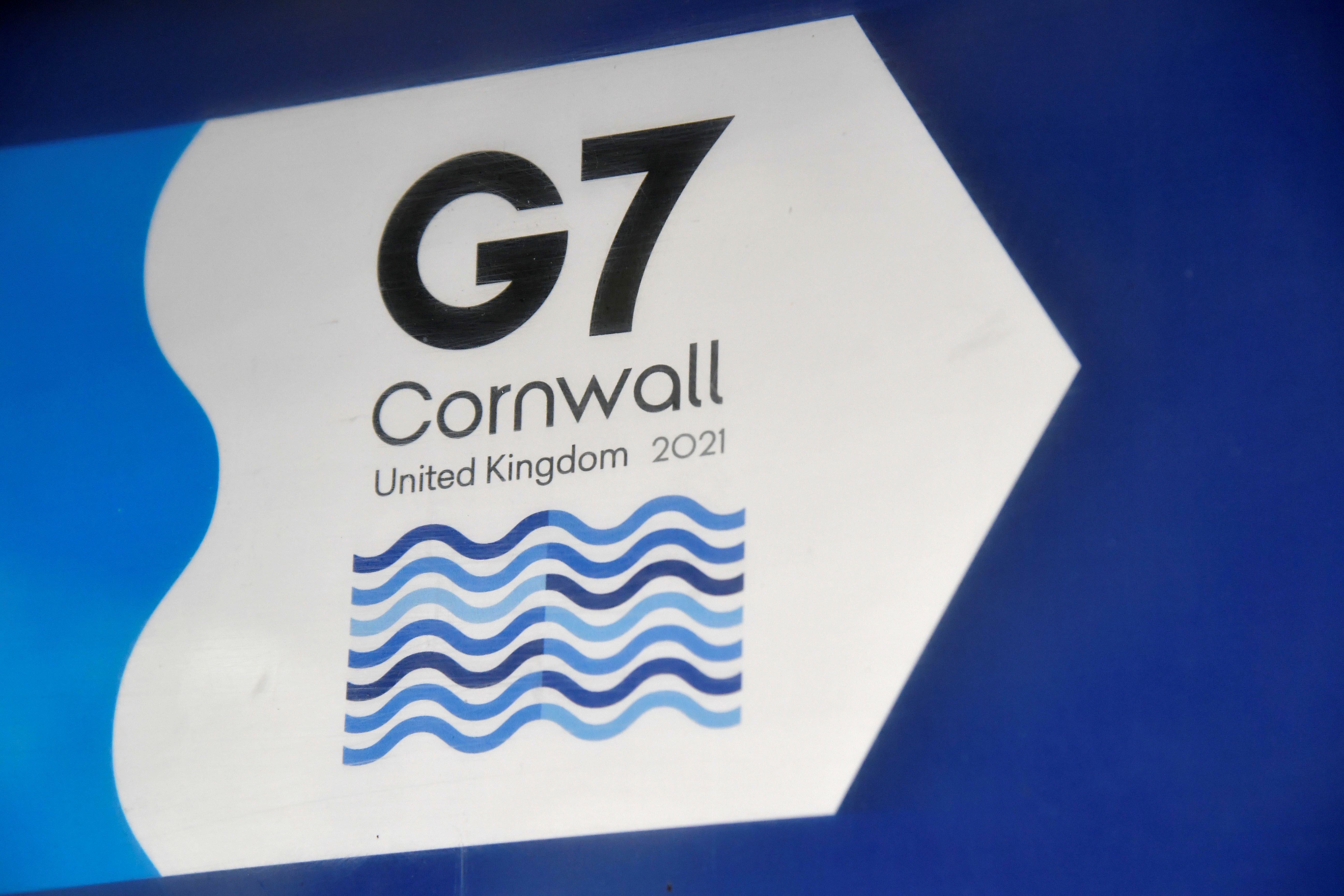 A G7 logo is seen on an information sign near the Carbis Bay hotel resort, where an in-person G7 summit of global leaders is due to take place in June, St Ives, Cornwall, southwest Britain May 24, 2021. Picture taken May 24, 2021. REUTERS/Toby Melville