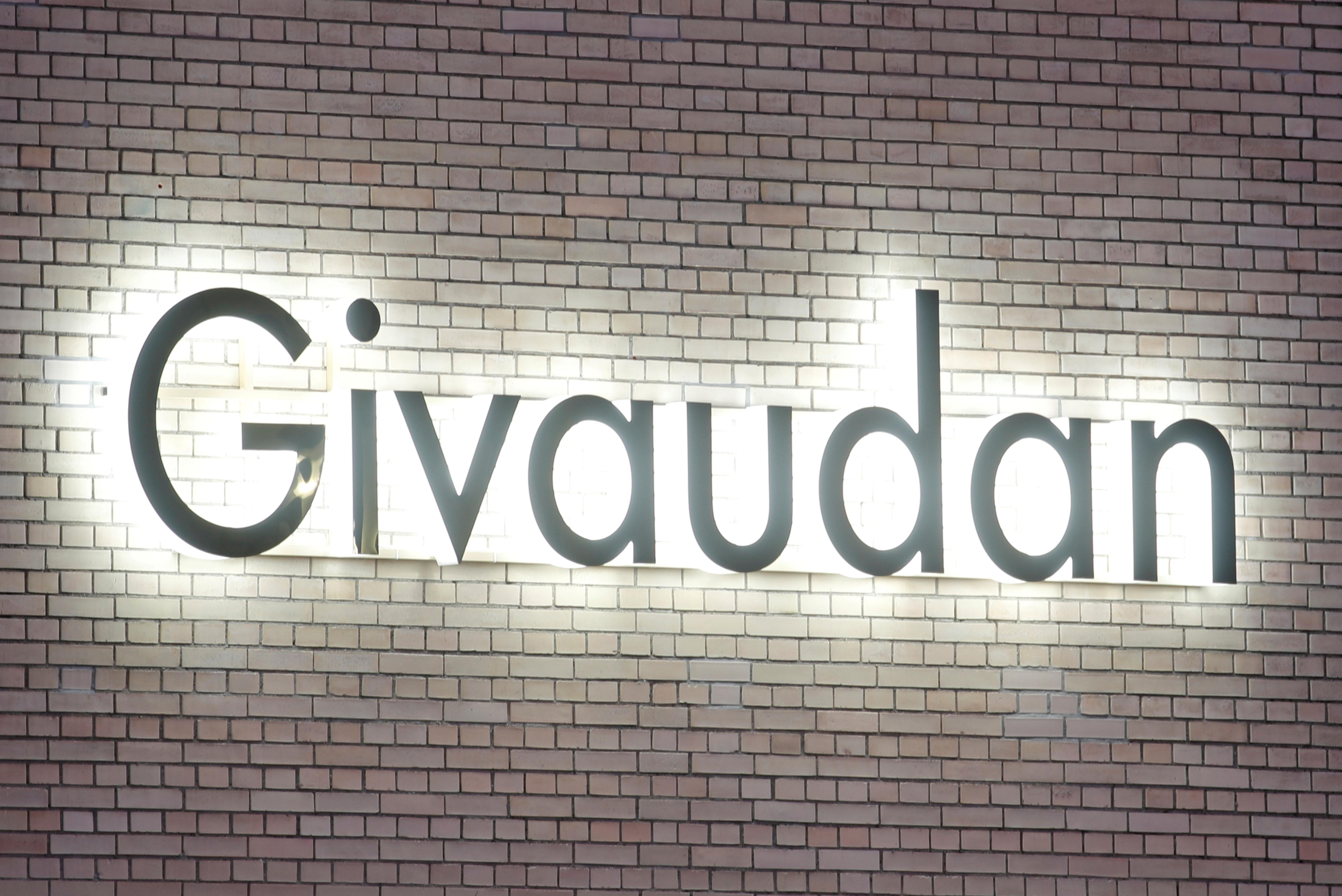The logo of Swiss flavours and fragrances maker Givaudan is seen at its innovation center in Kemptthal, Switzerland January 10, 2020. REUTERS/Arnd Wiegmann