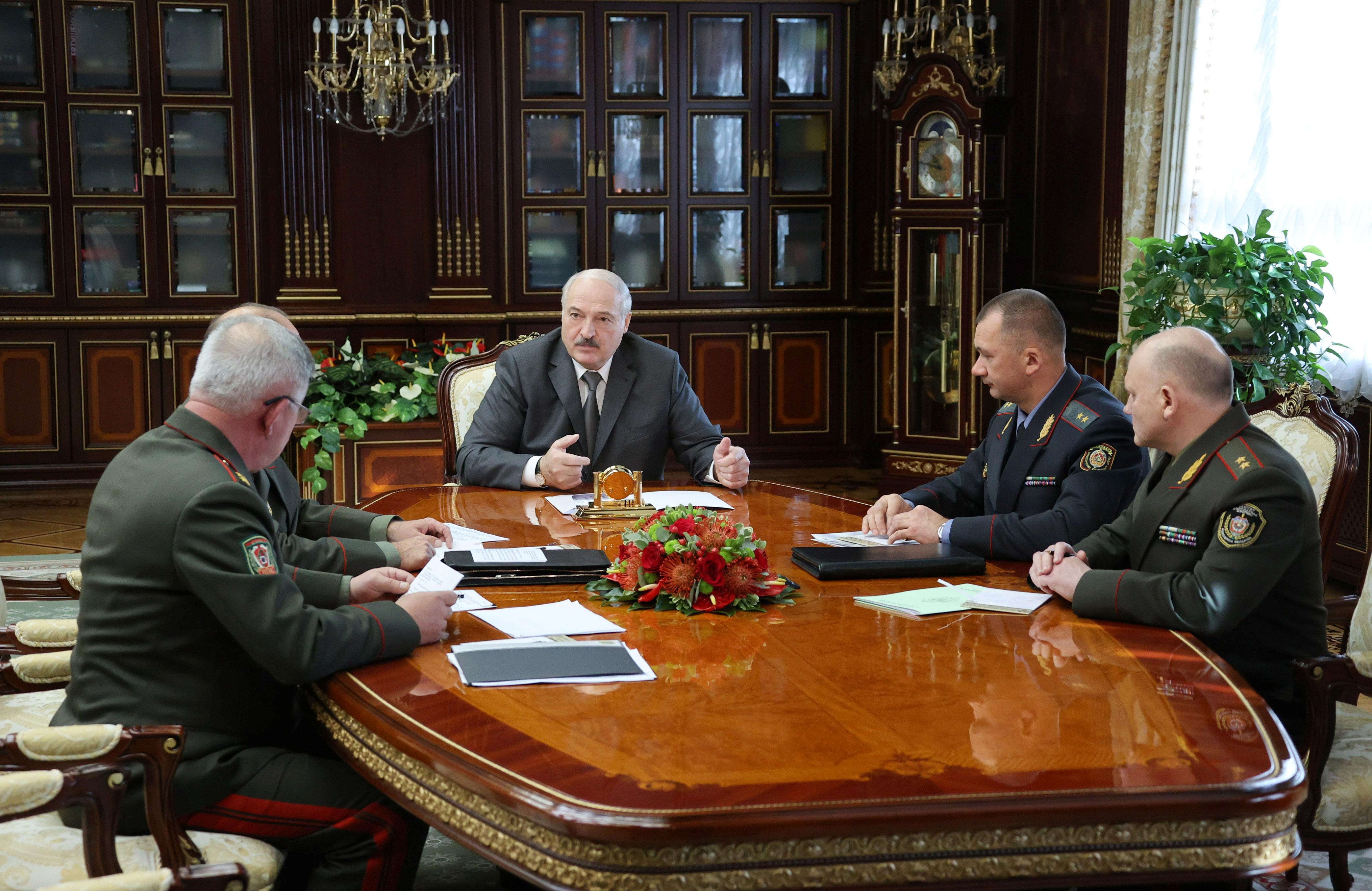 Belarusian President Alexander Lukashenko meets state security officials in Minsk, Belarus September 27, 2021.  Maxim Guchek/BelTA
