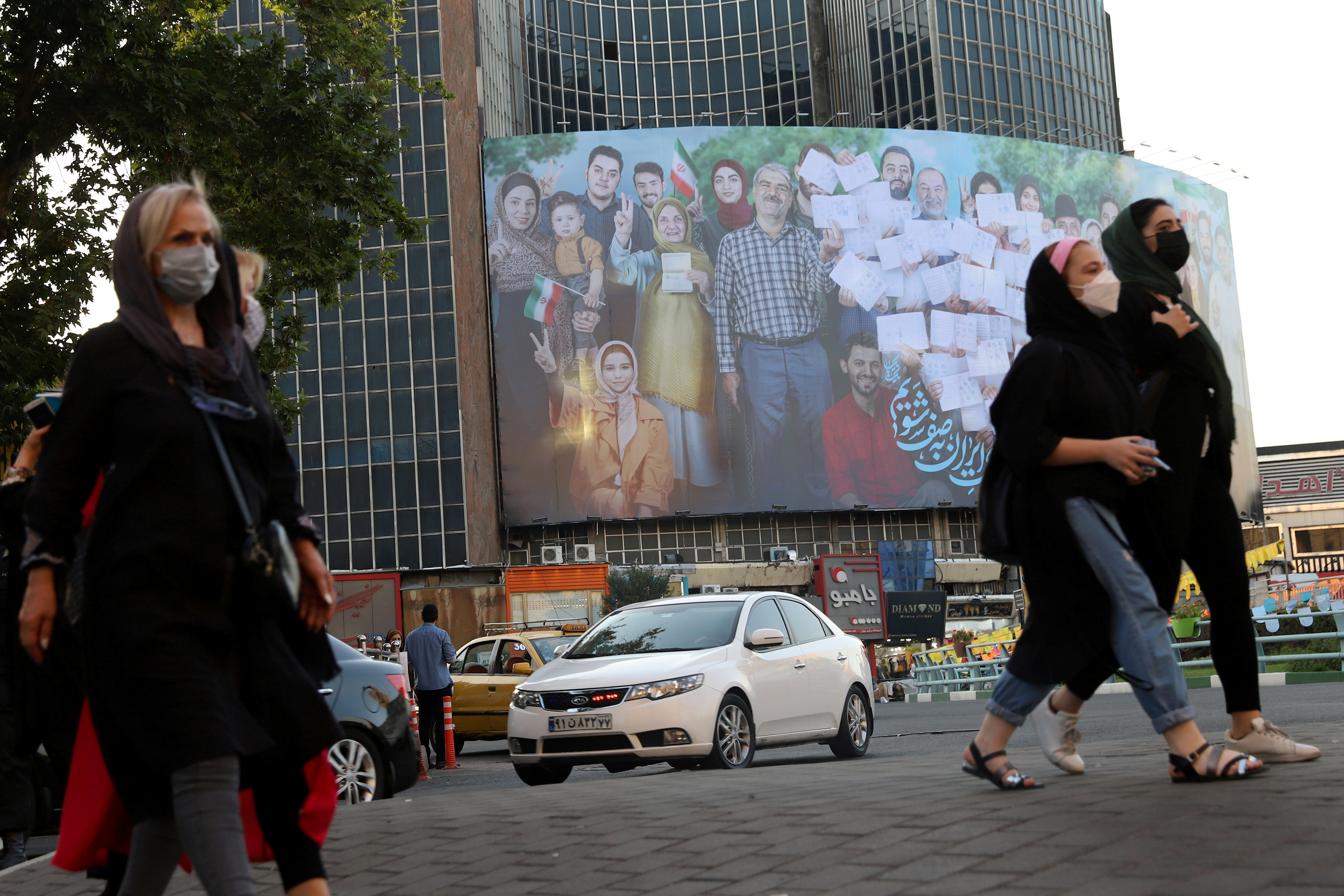 A banner of the presidential election is seen in Valiasr square in Tehran, Iran June 16, 2021. Majid Asgaripour/WANA (West Asia News Agency) via REUTERS