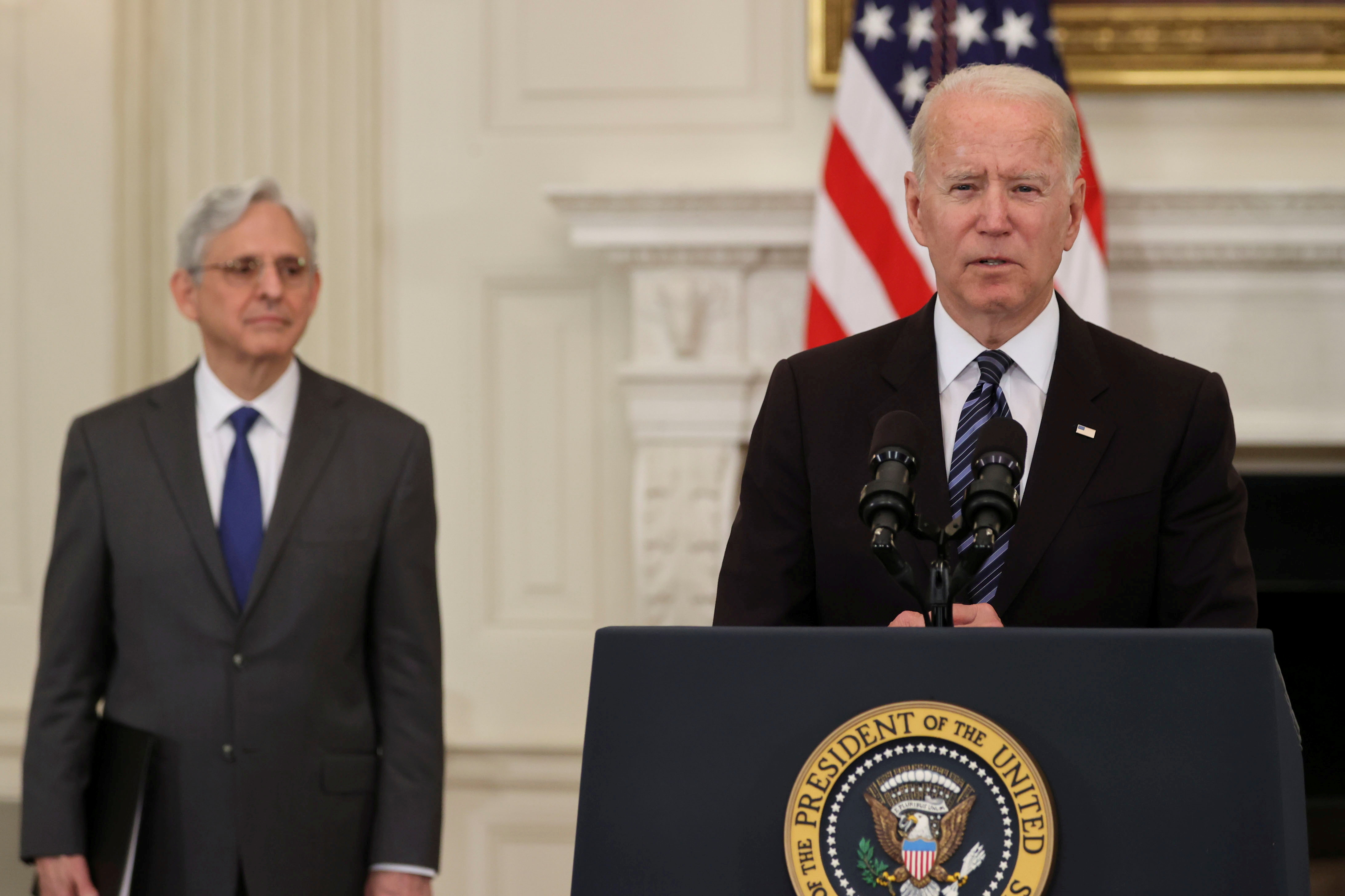 U.S. President Joe Biden delivers remarks accompanied by U.S. Attorney General Merrick Garland, after a roundtable discussion with advisors on steps to curtail U.S. gun violence, at the White House in Washington, U.S. June 23, 2021. REUTERS/Jonathan Ernst/File Photo