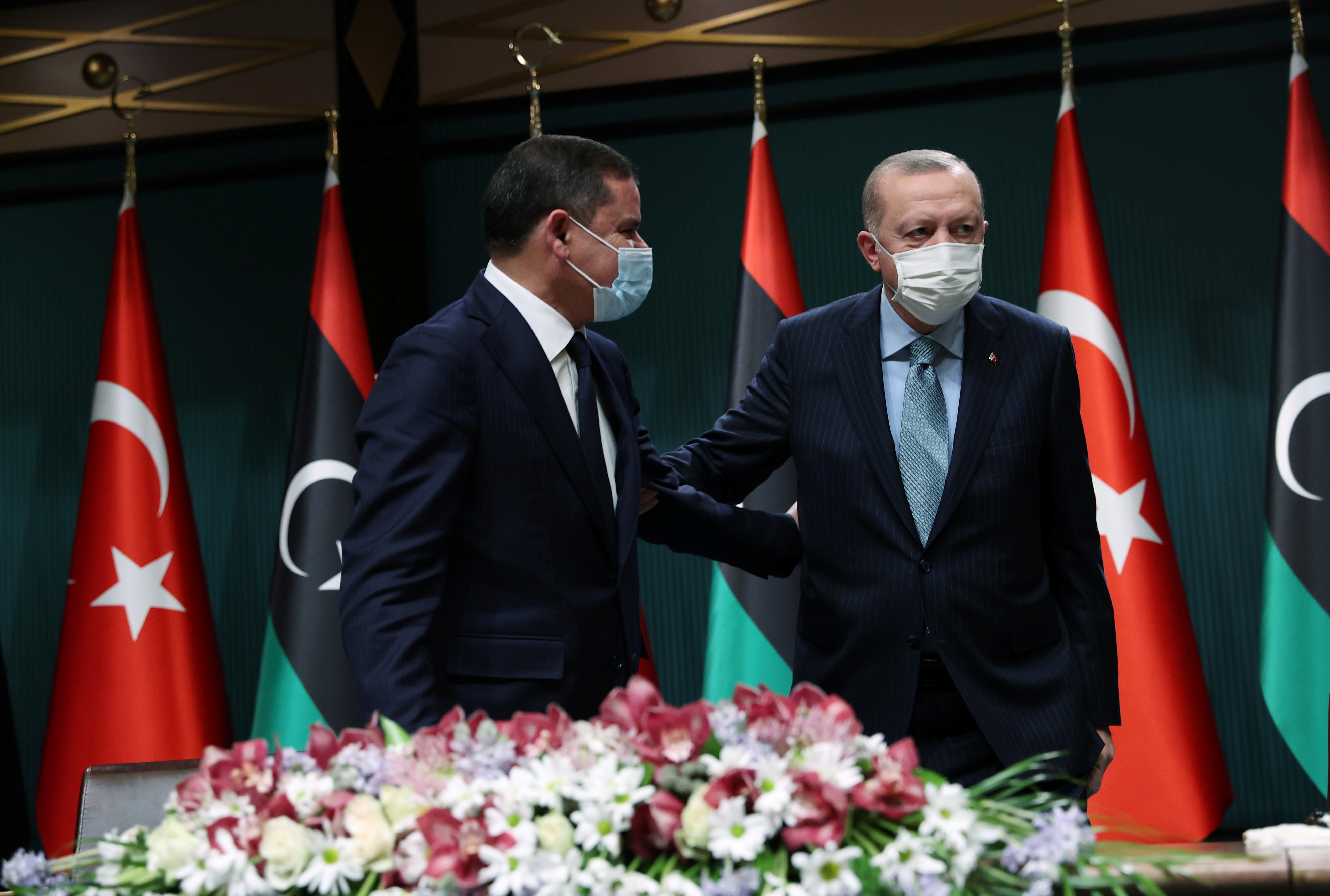 Turkish President Tayyip Erdogan and Libyan Prime Minister Abdulhamid Dbeibeh leave after a news conference in Ankara, Turkey April 12, 2021. Presidential Press Office/Handout via REUTERS
