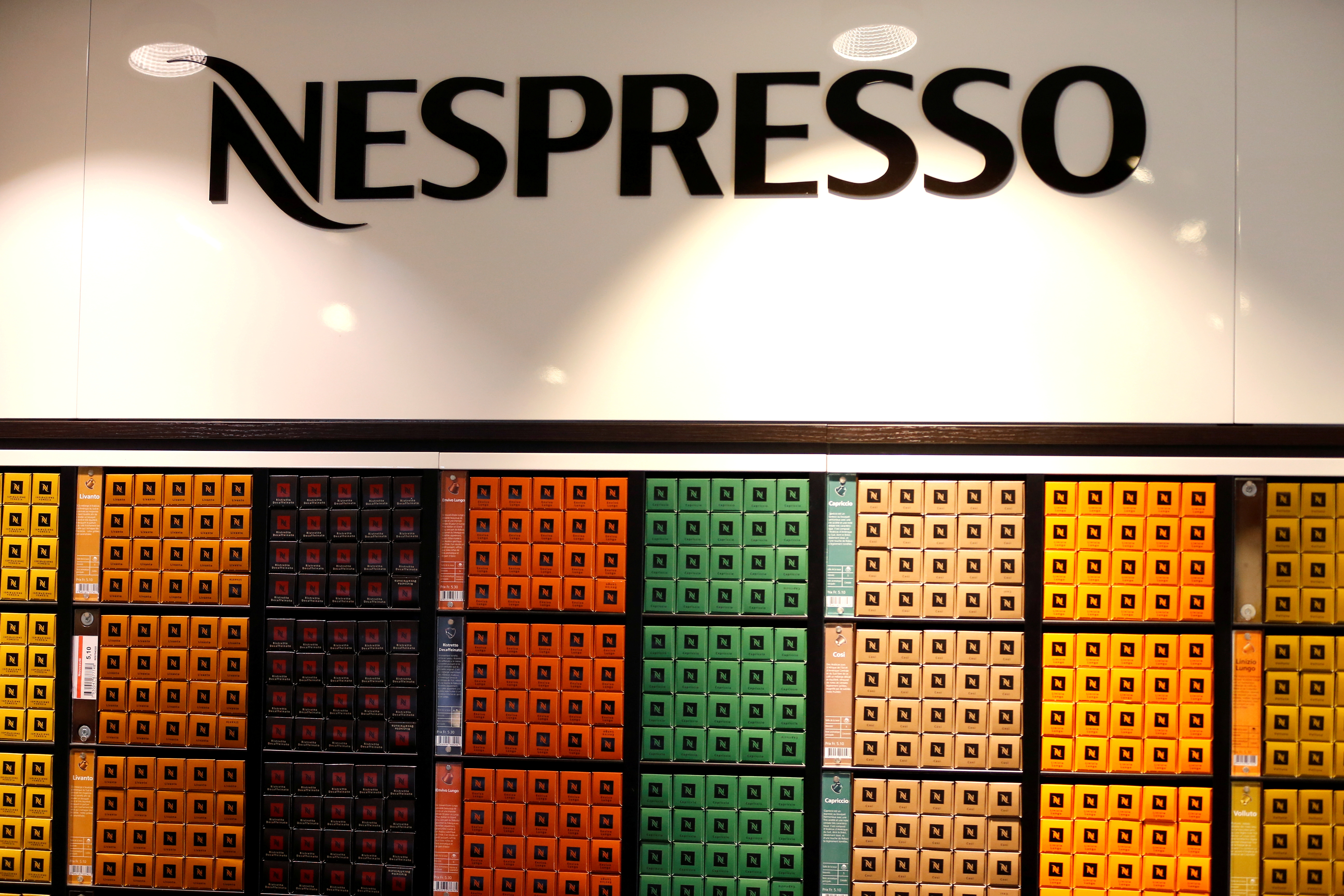 The Nespresso logo and boxes of Nespresso coffee pods are pictured in the supermarket of Nestle headquarters in Vevey, Switzerland, February 13, 2020. REUTERS/Pierre Albouy/File Photo