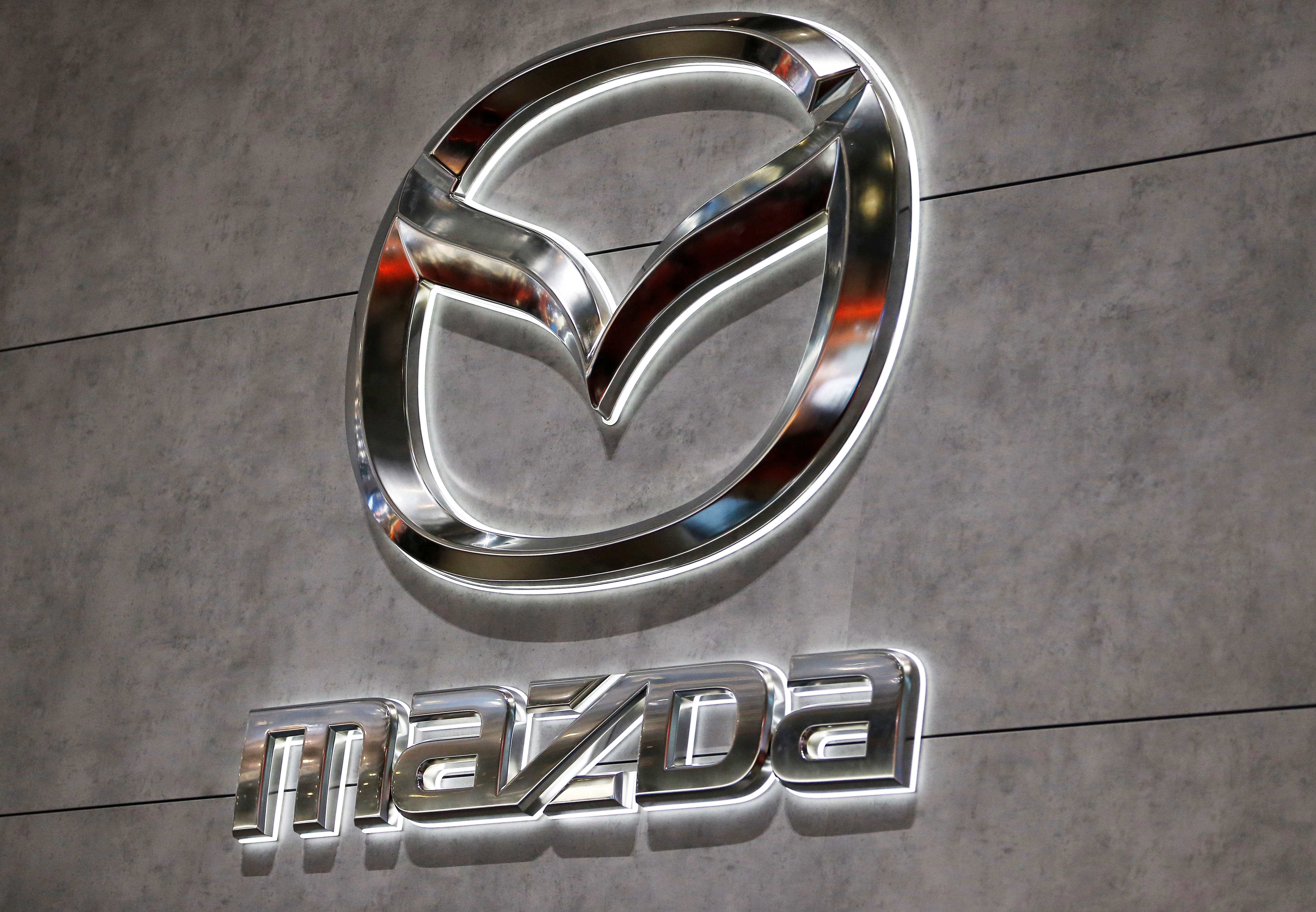 A Mazda logo is displayed at the 89th Geneva International Motor Show in Geneva, Switzerland March 5, 2019.  REUTERS/Pierre Albouy/Files