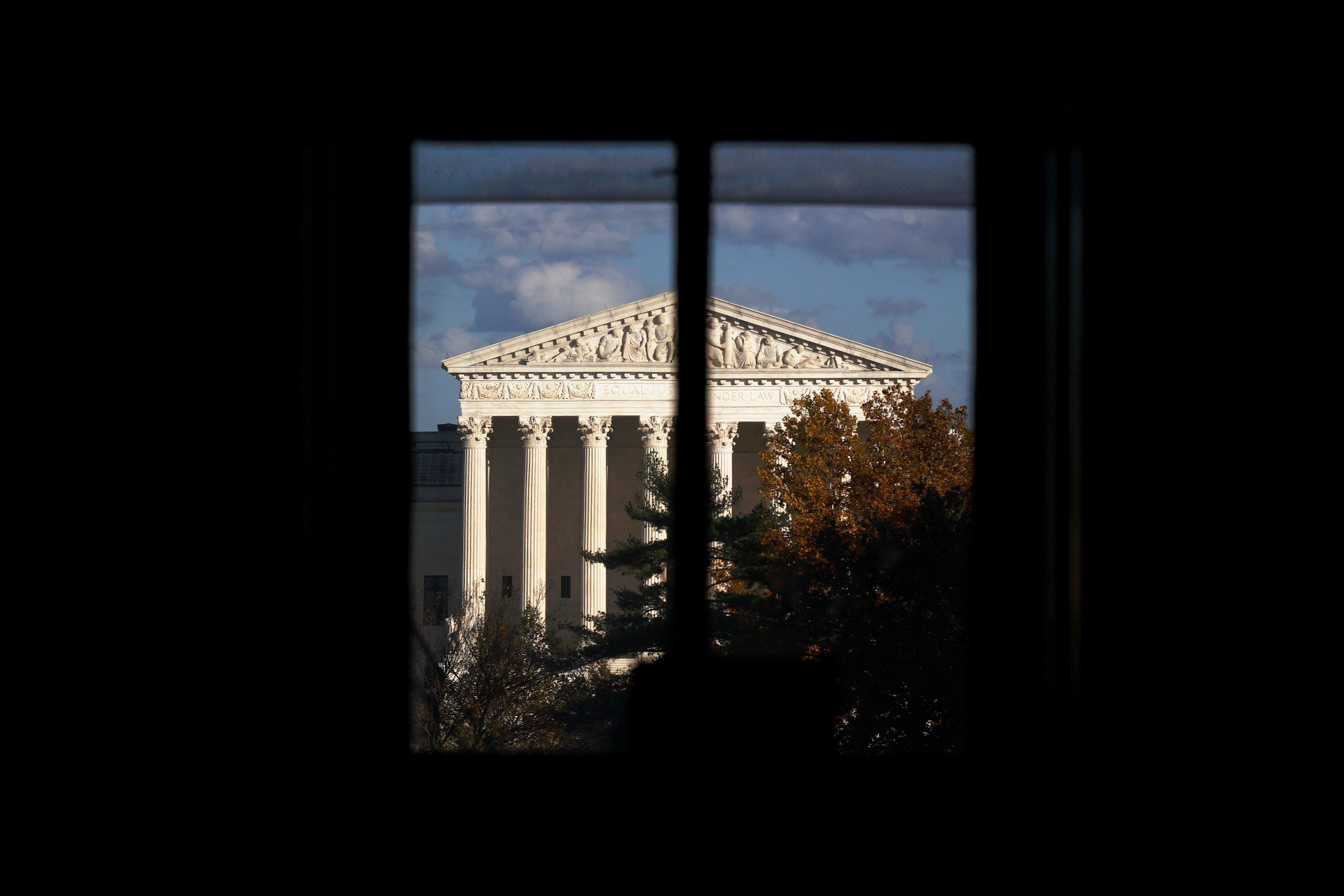 The U.S. Supreme Court building is seen behind a window in Washington, U.S. November 10, 2020. REUTERS/Hannah McKay