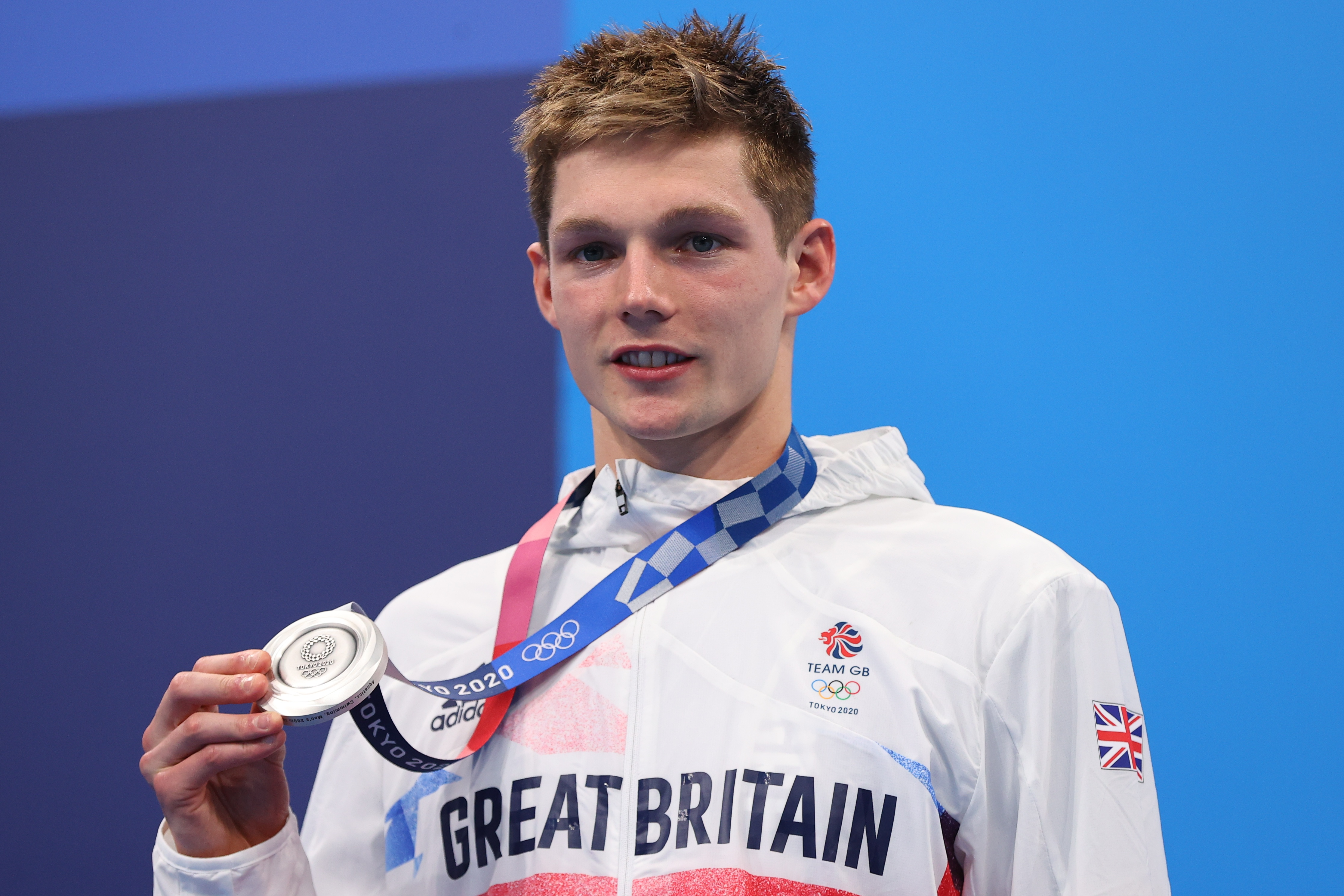 Tokyo 2020 Olympics - Swimming - Men's 200m Individual Medley - Medal Ceremony - Tokyo Aquatics Centre - Tokyo, Japan - July 30, 2021. Duncan Scott of Britain poses on the podium with the silver medal REUTERS/Marko Djurica