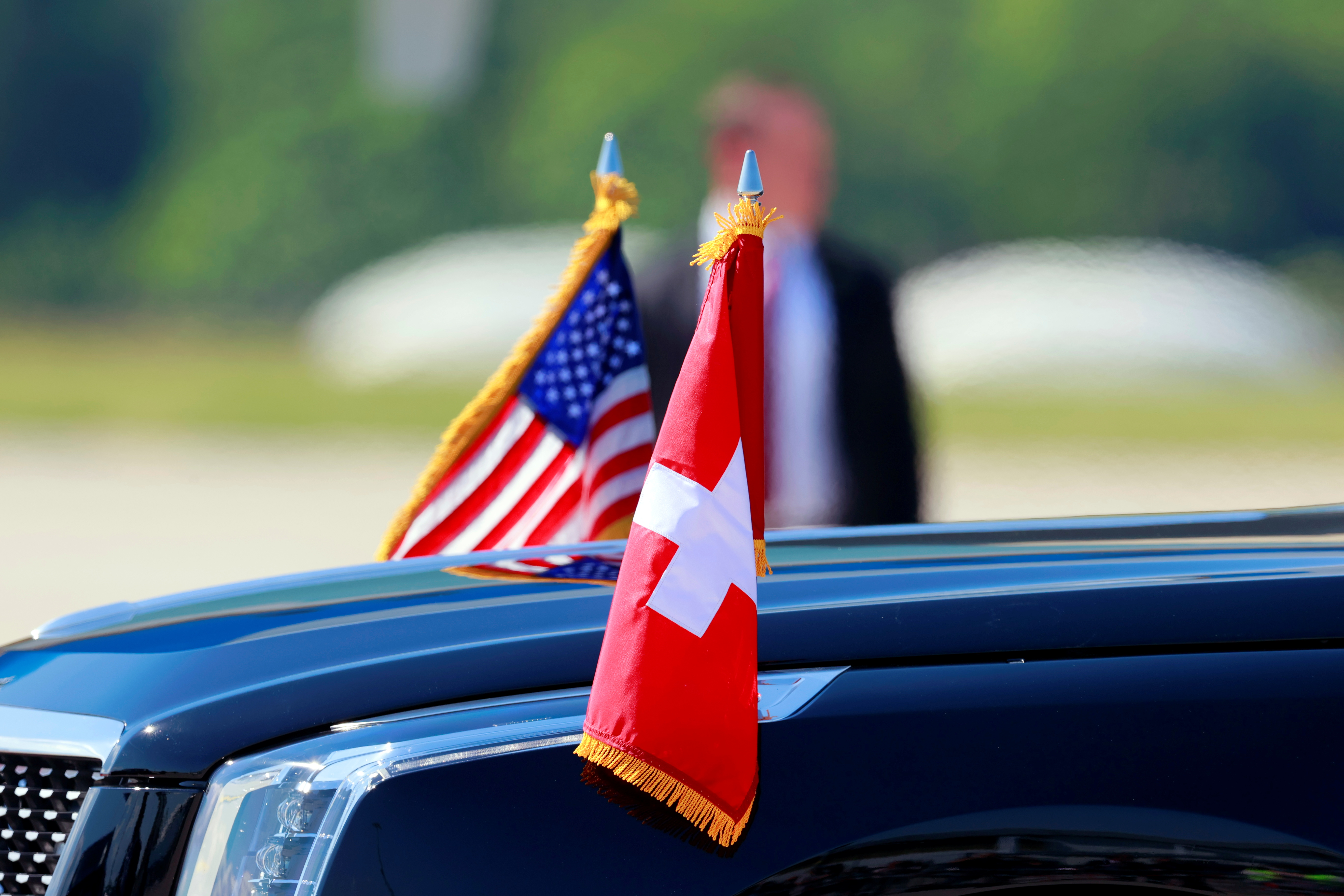 Flags of the U.S. and Switzerland are attached to a car during the arrival of U.S. President Joe Biden at Cointrin airport, ahead of a meeting with Russian counterpart Vladimir Putin in Geneva, Switzerland, June 15, 2021. REUTERS/Denis Balibouse/Pool