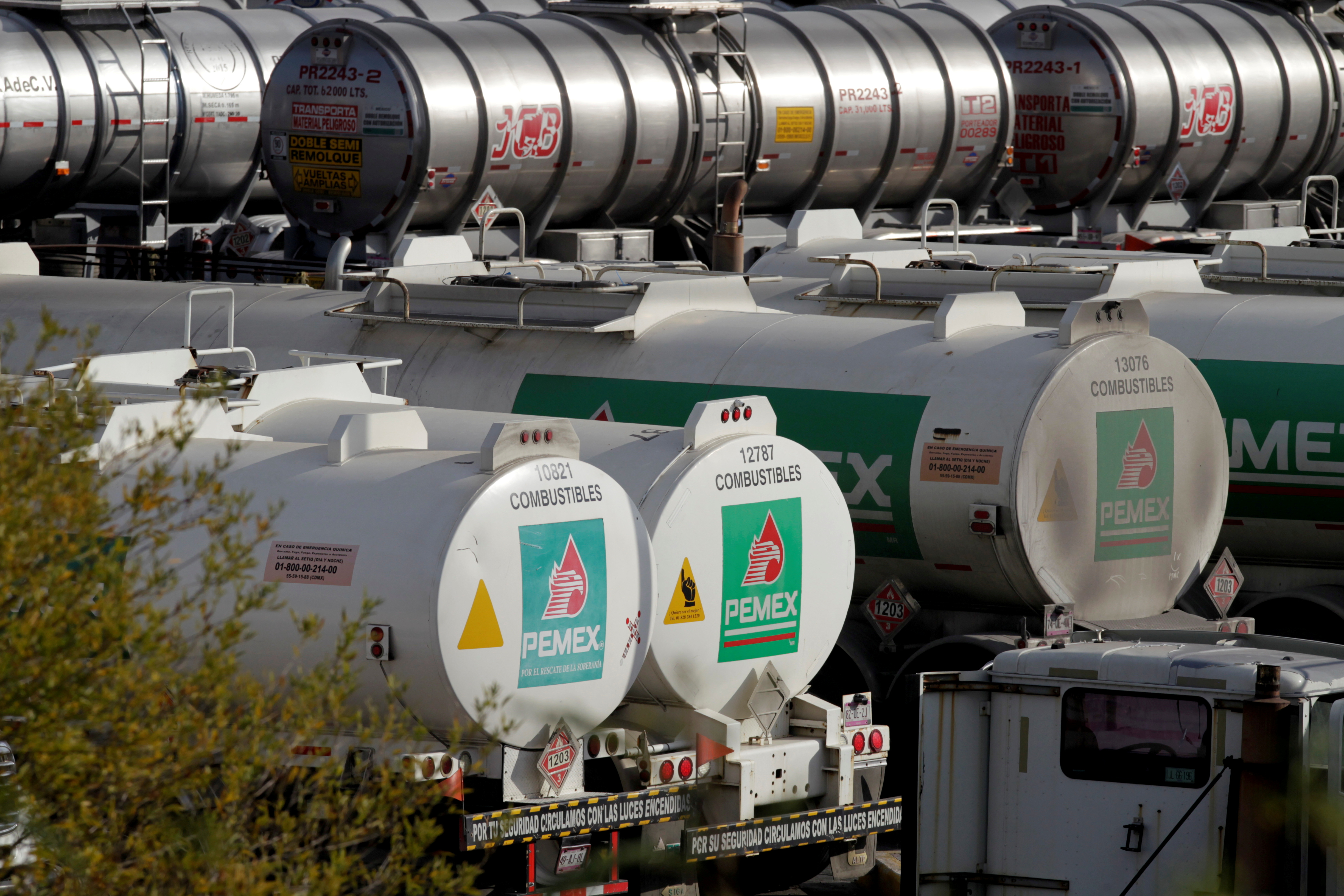 Tanker trucks are pictured at Mexican state oil firm Pemex's Cadereyta refinery in Cadereyta, on the outskirts of Monterrey, Mexico, December 10, 2020. REUTERS/Daniel Becerril