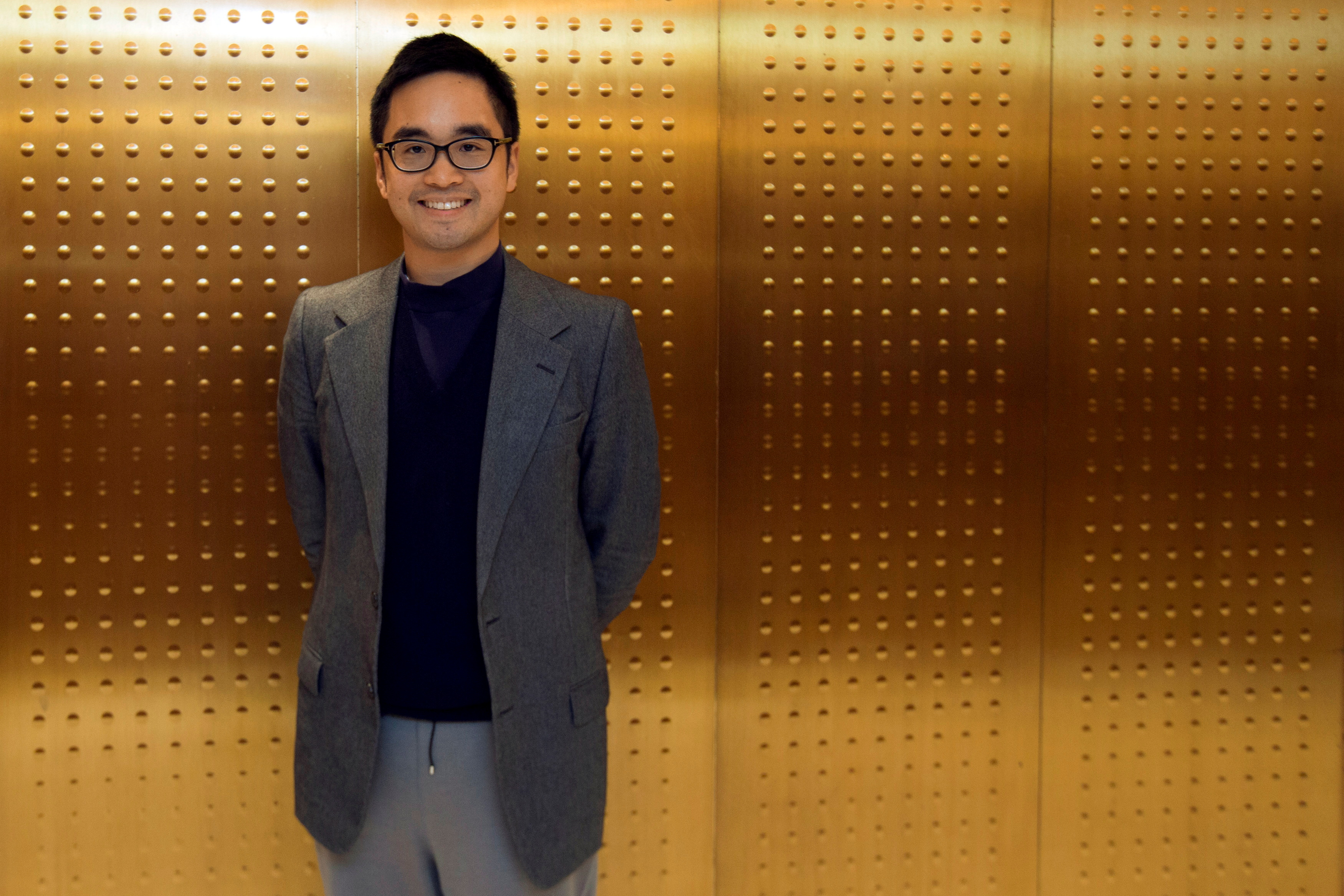 Hong Kong billionaire Adrian Cheng, the 33-year-old grandson of Hong Kong tycoon Cheng Yu-teng, poses for a photograph before an interview with Reuters at his office in Hong Kong April 11, 2013. Cheng is one of a new generation of business leaders in Asia who are taking over the corporate reins from their ageing rags-to-riches forebears. Picture taken April 11, 2013. To match Interview HONGKONG-CHOWTAIFOOK/CHENG       REUTERS/Tyrone Siu (CHINA - Tags: BUSINESS SOCIETY WEALTH)/File Photo