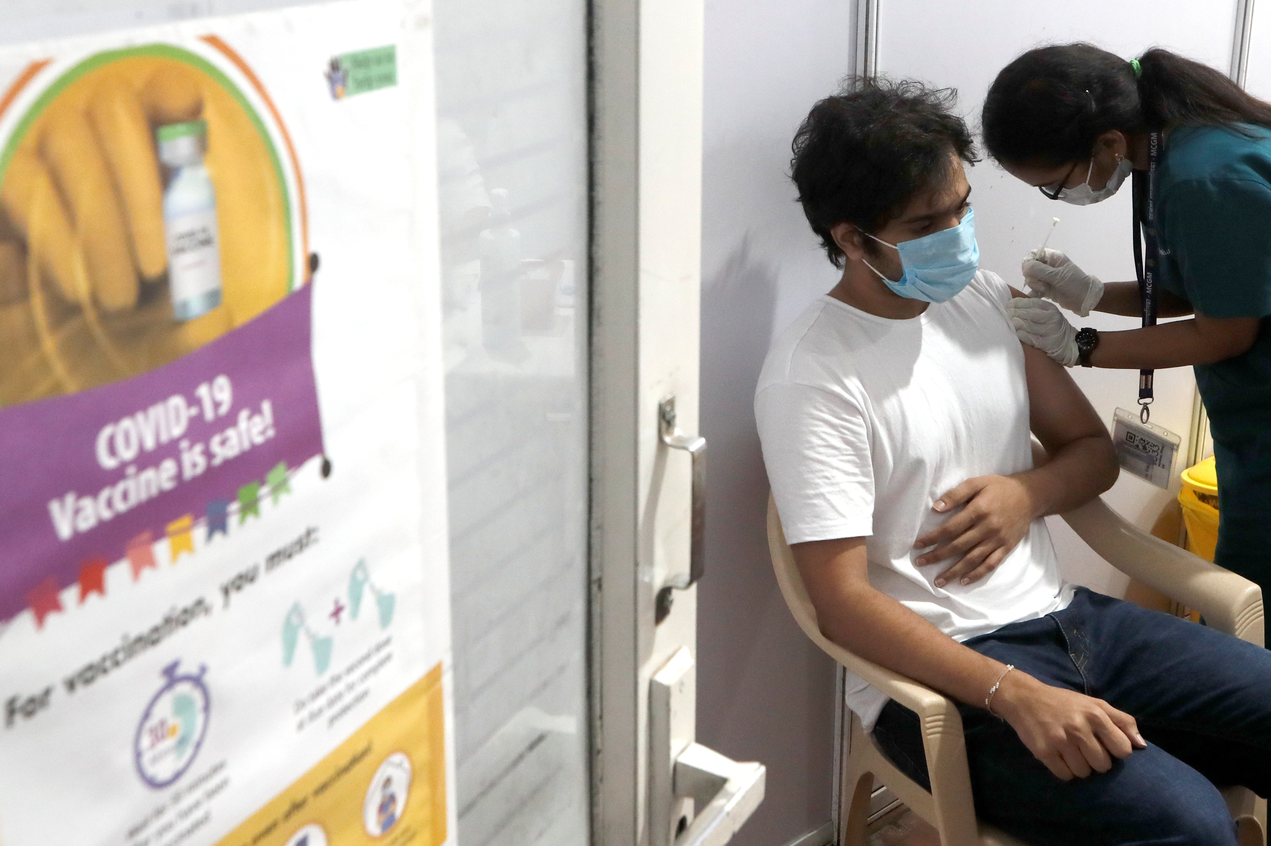 A man receives a dose of COVISHIELD, a coronavirus disease (COVID-19) vaccine manufactured by Serum Institute of India, at a vaccination centre in Mumbai, India, May 1, 2021. REUTERS/Francis Mascarenhas