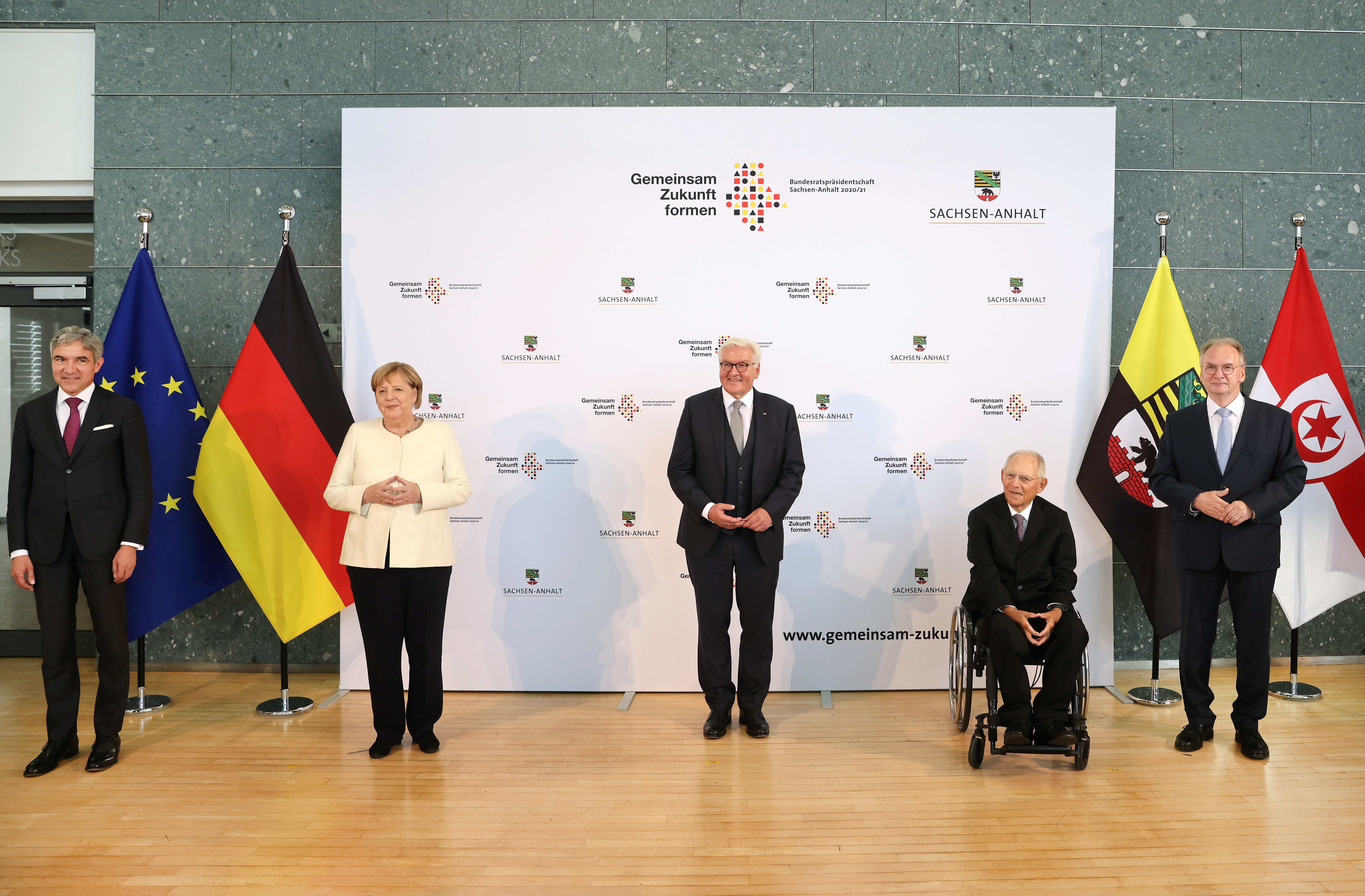 Germany's Federal Constitutional Court president Stephan Harbarth, outgoing German Chancellor Angela Merkel, German President Frank-Walter Steinmeier, President of the Bundestag Wolfgang Schauble and Saxony-Anhalt State Premier Reiner Haseloff stand for a group picture before a ceremony to mark the 31st anniversary of Germany's Unification Day, in the city of Halle, Germany, October 3, 2021. Jan Woitas/Pool via REUTERS