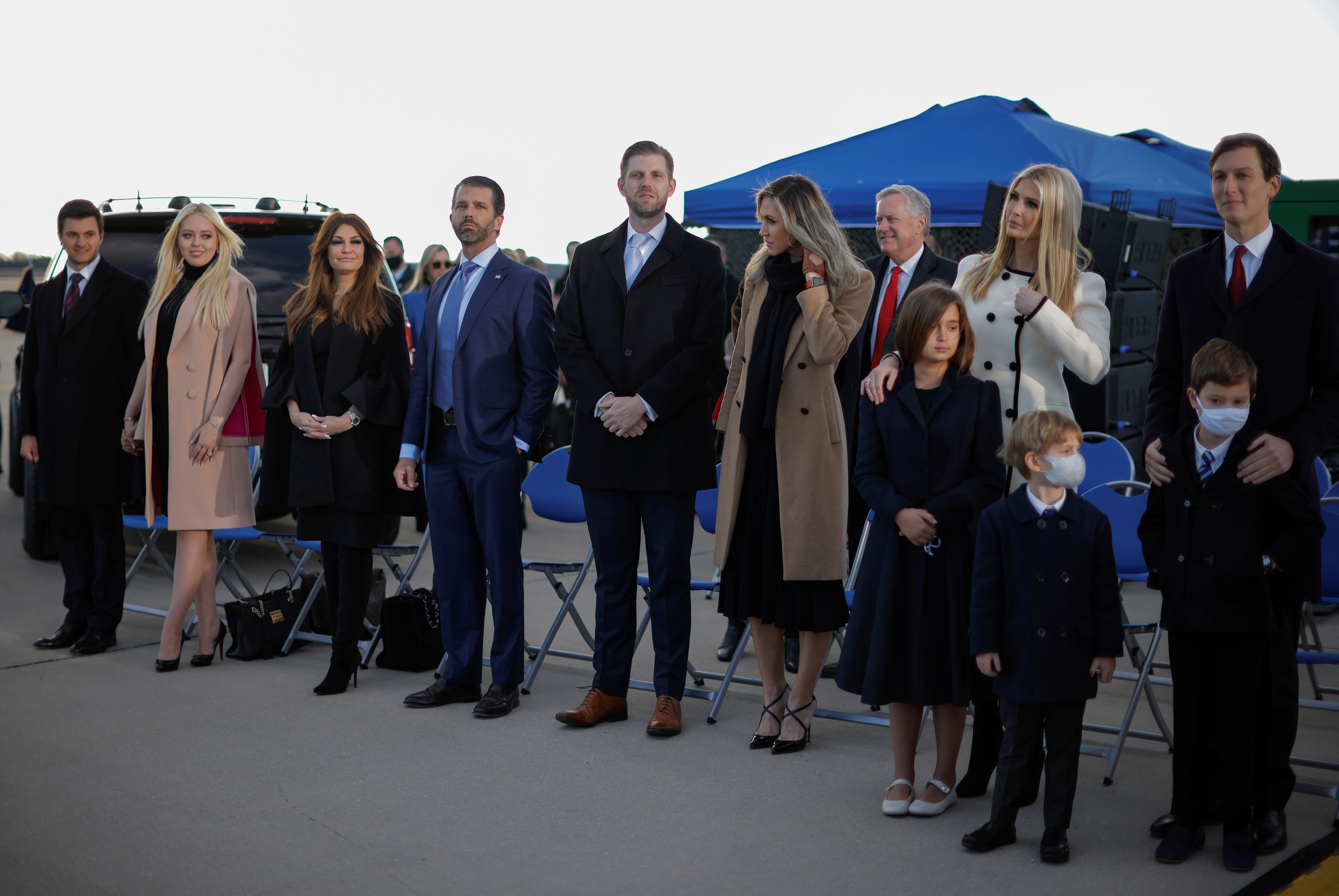 Donald Trump Jr, Ivanka Trump, her husband Jared Kushner and family members attend the departure ceremony of U.S. President Donald Trump at the Joint Base Andrews, Maryland, U.S., January 20, 2021. REUTERS/Carlos Barria