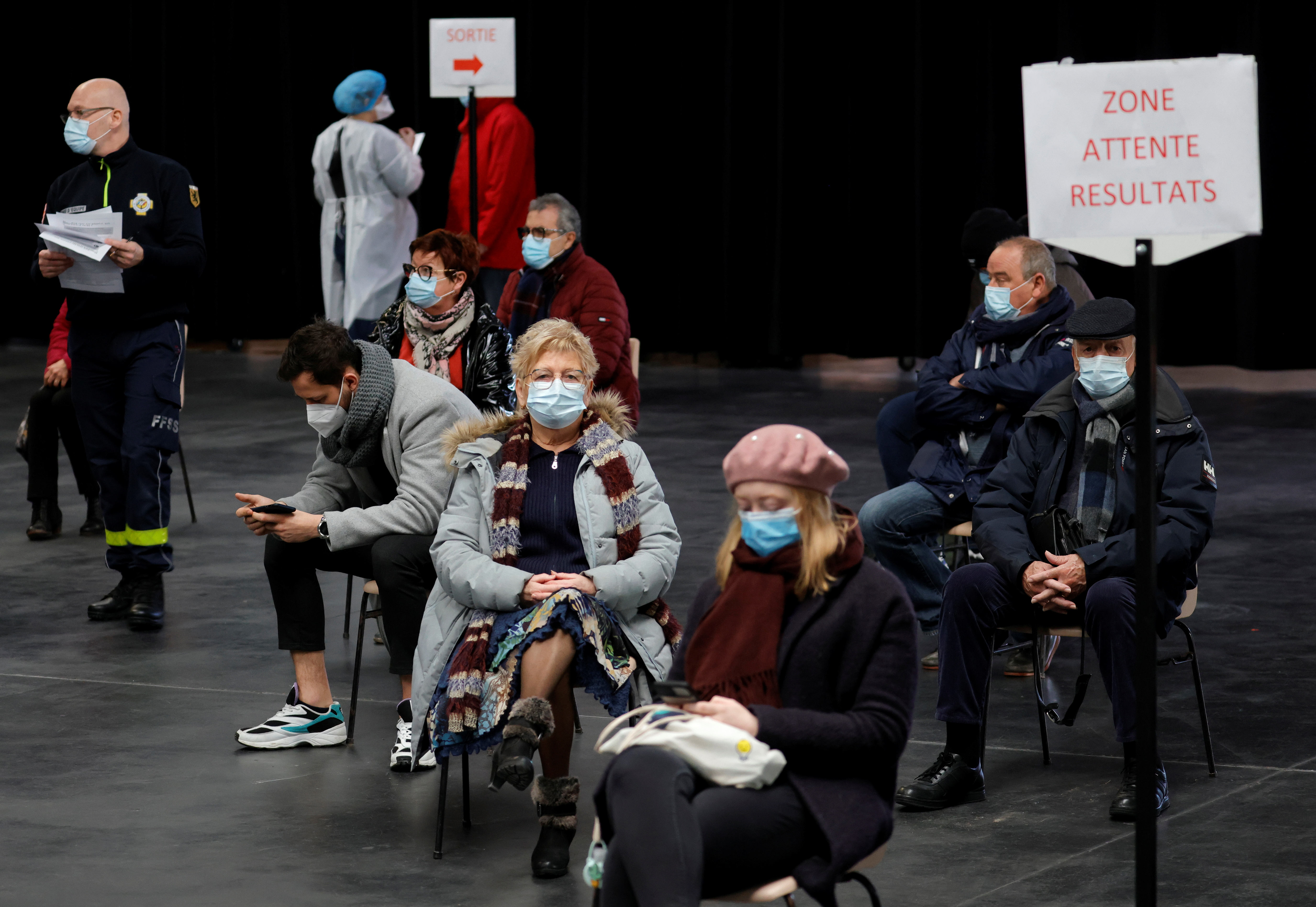 People, wearing protective face masks, wait for their test results at a coronavirus disease (COVID-19) testing center installed inside in the Kursaal concert hall in Dunkirk, France, February 18, 2021.  REUTERS/Pascal Rossignol/File Photo