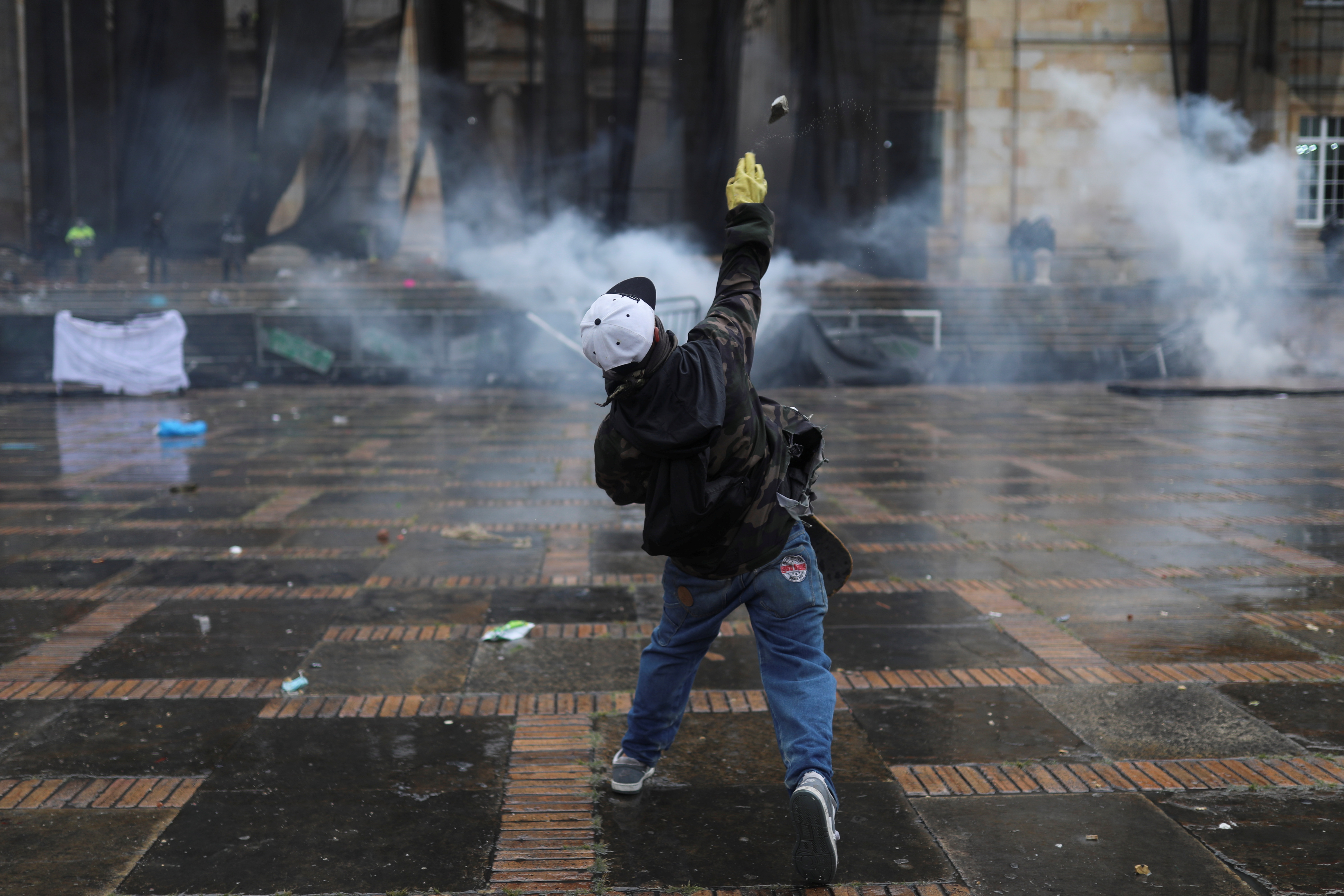 A demonstrator throws an object during a protest against poverty and police violence in Bogota, Colombia, May 5, 2021. REUTERS/Luisa Gonzalez
