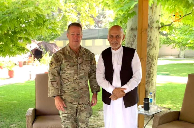 Afghanistan's President Ashraf Ghani (R) meets General Austin