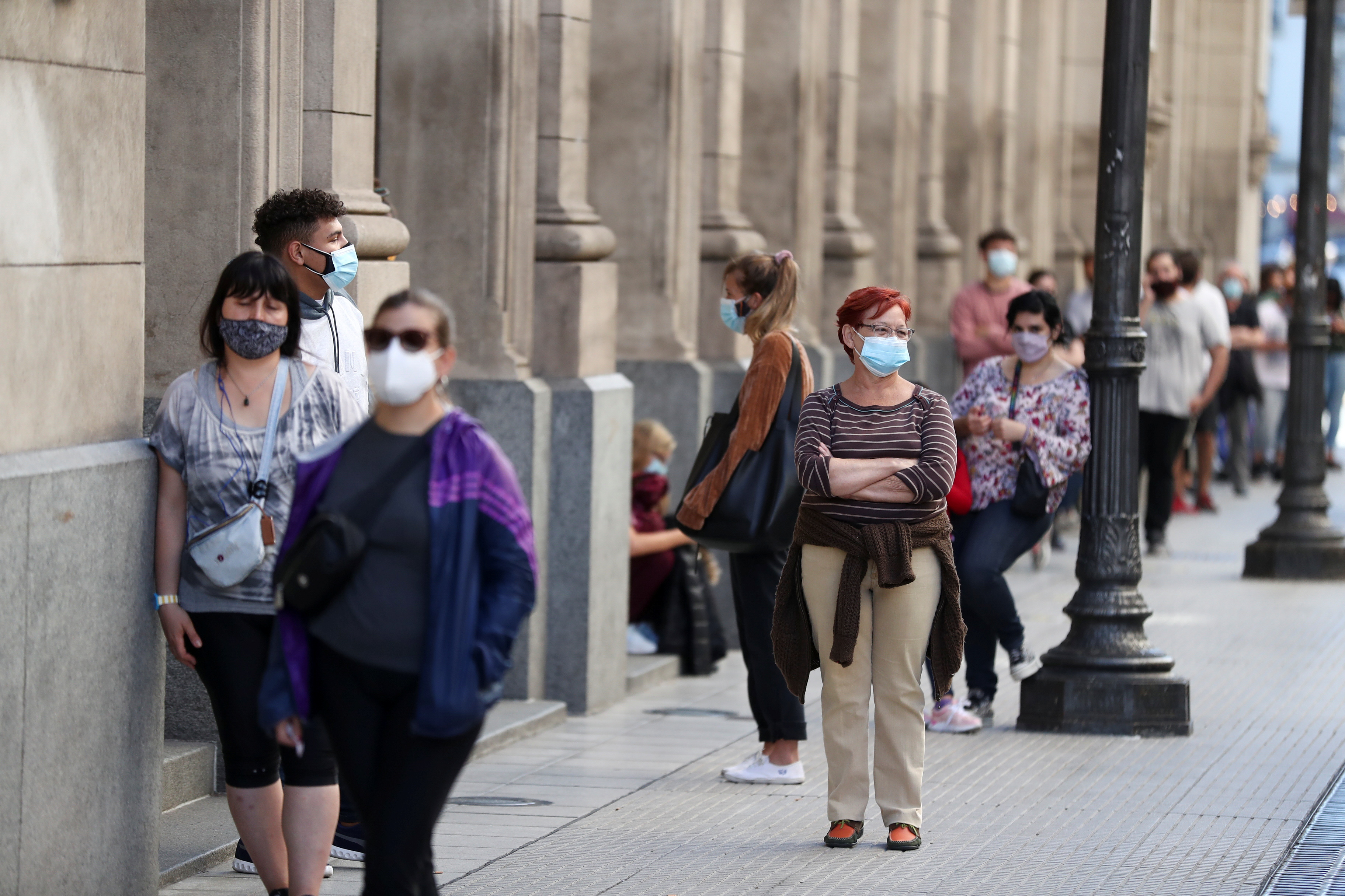 People wearing face masks wait in line to be tested for the coronavirus disease (COVID-19) at the Colon Theatre, in Buenos Aires, Argentina April 13, 2021. REUTERS/Agustin Marcarian