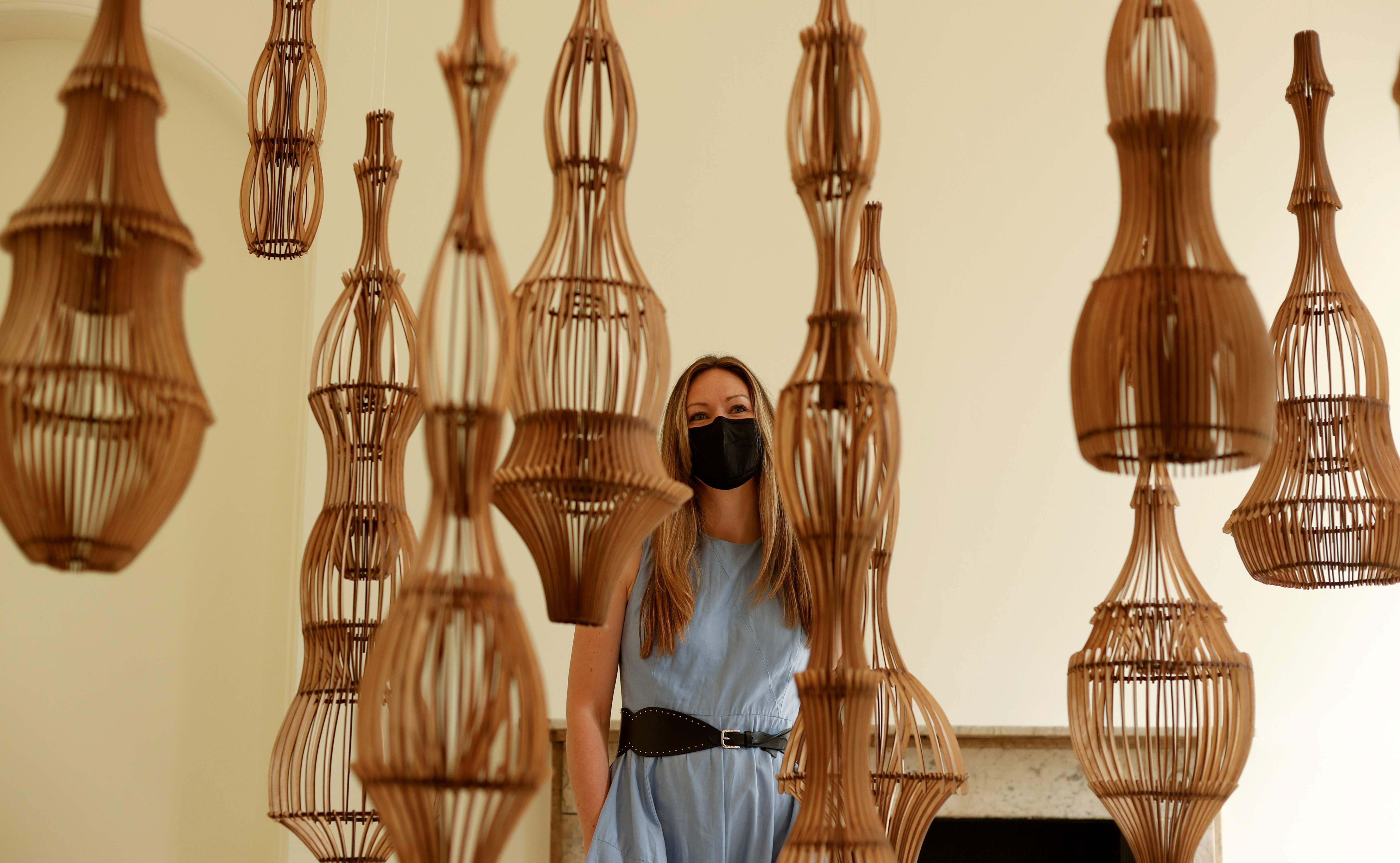 Artist Naomi McIntosh poses for a photograph with her creation 'Ruup & Form Quiet Garden' at the London Design Biennale at Somerset House in London, Britain, June 1, 2021. REUTERS/John Sibley