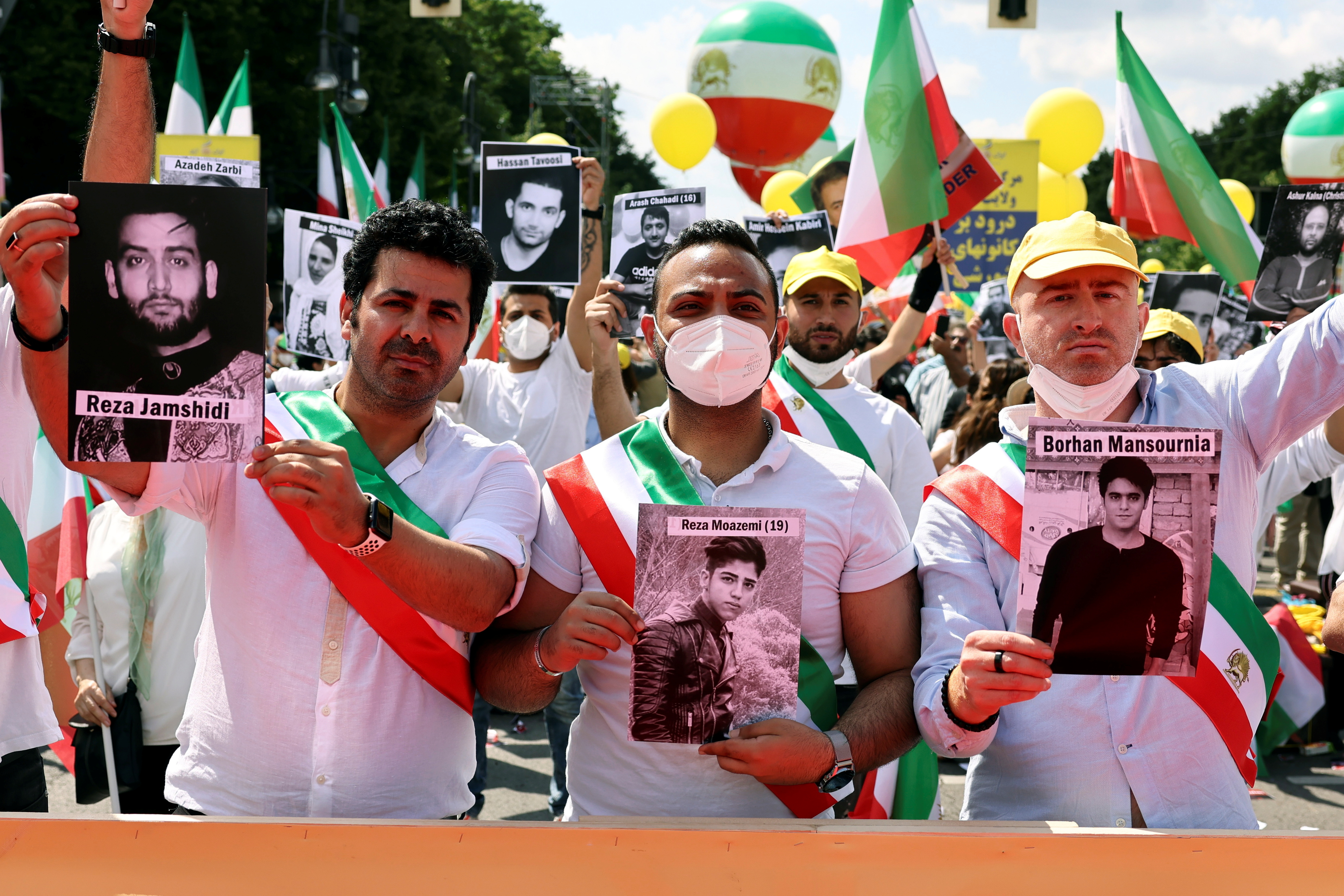 Supporters of the National Council of Resistance of Iran (NCRI) gather to protest against the government in Teheran and the use of the death penalty in Iran, in front of the Brandenburg Gate in Berlin, Germany, July 10, 2021. REUTERS/Christian Mang